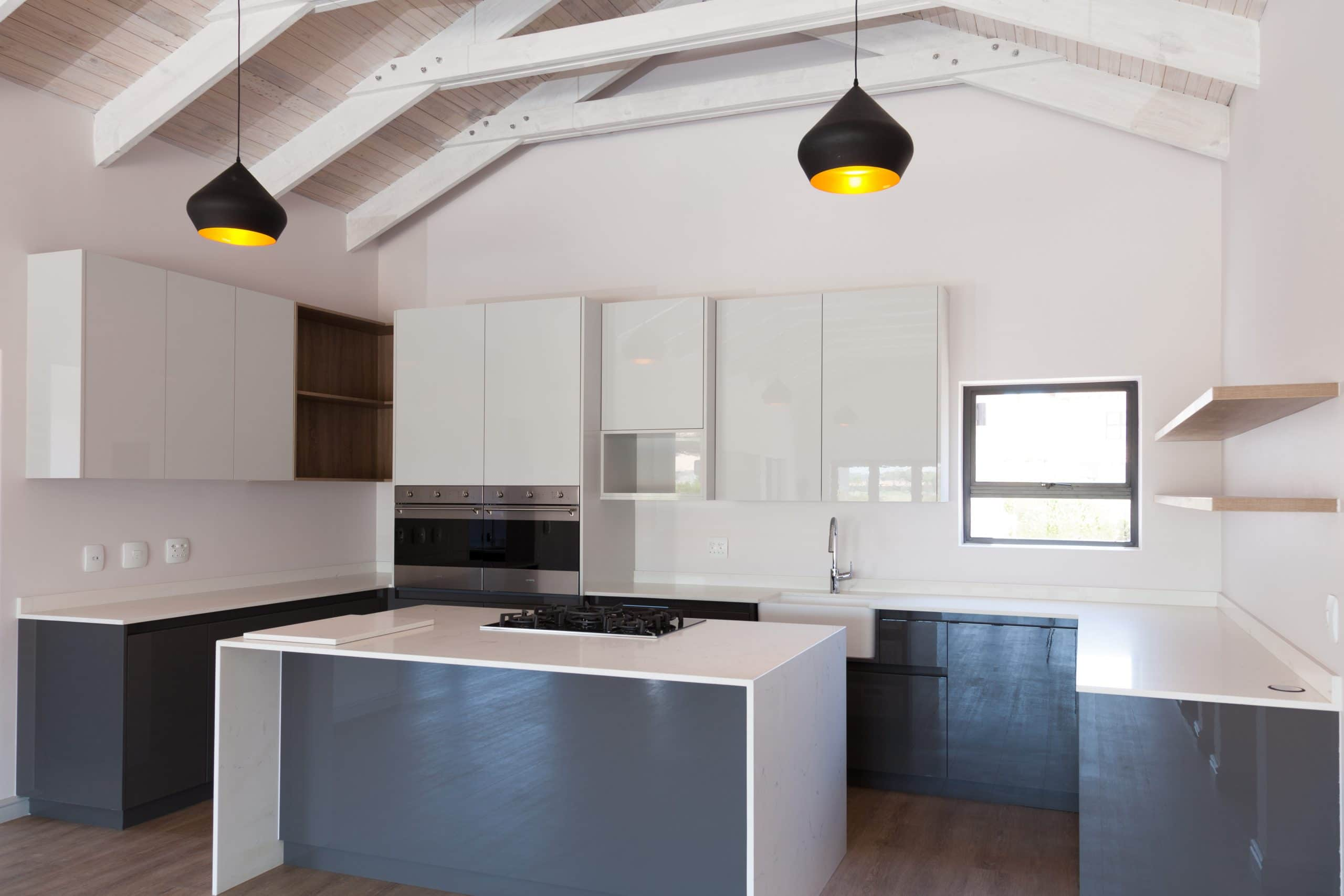 modern light and dark grey ktichen on wooden flooring langebaan country estate