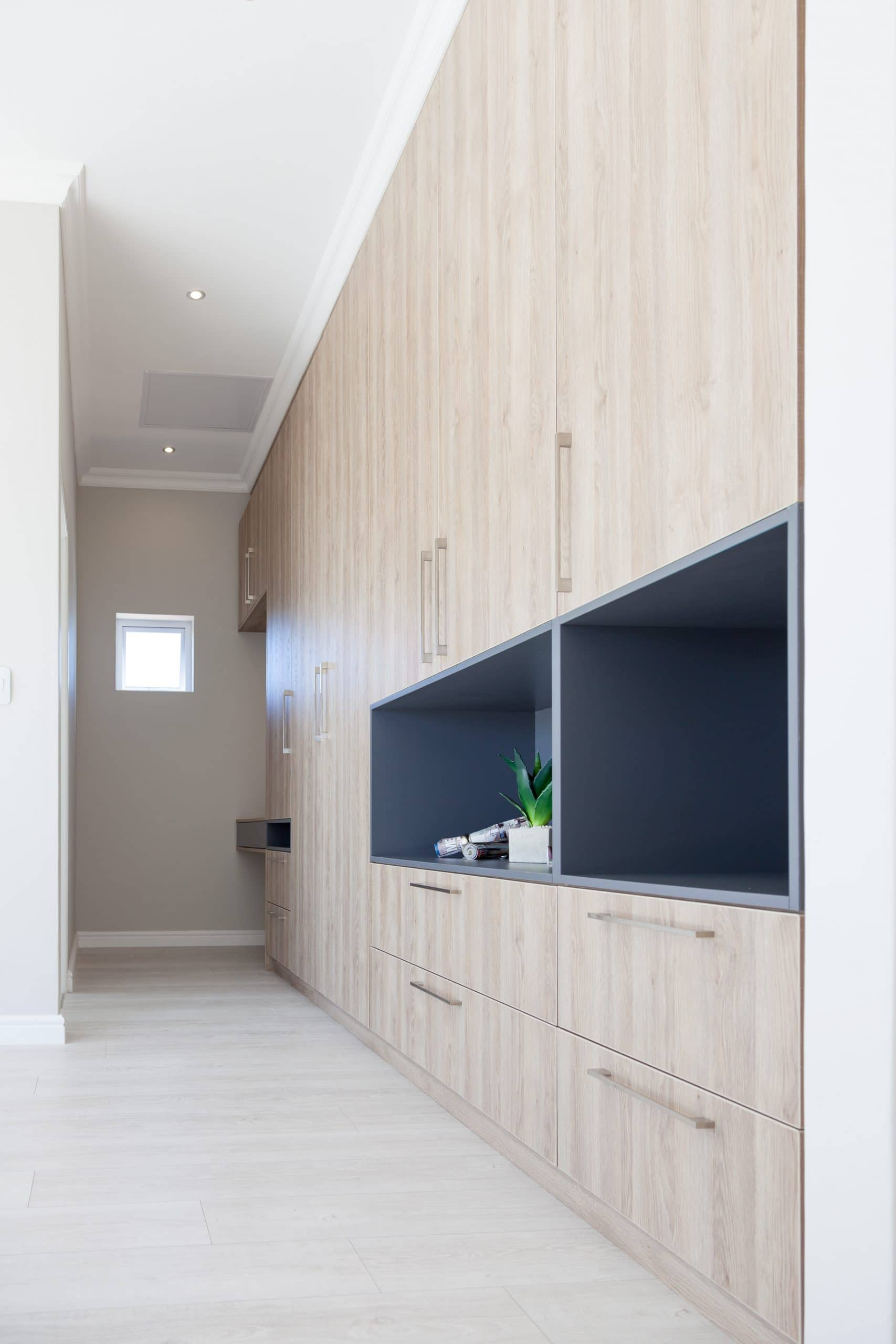 funky bedroom cupboard design with light wooden flooring and grey box