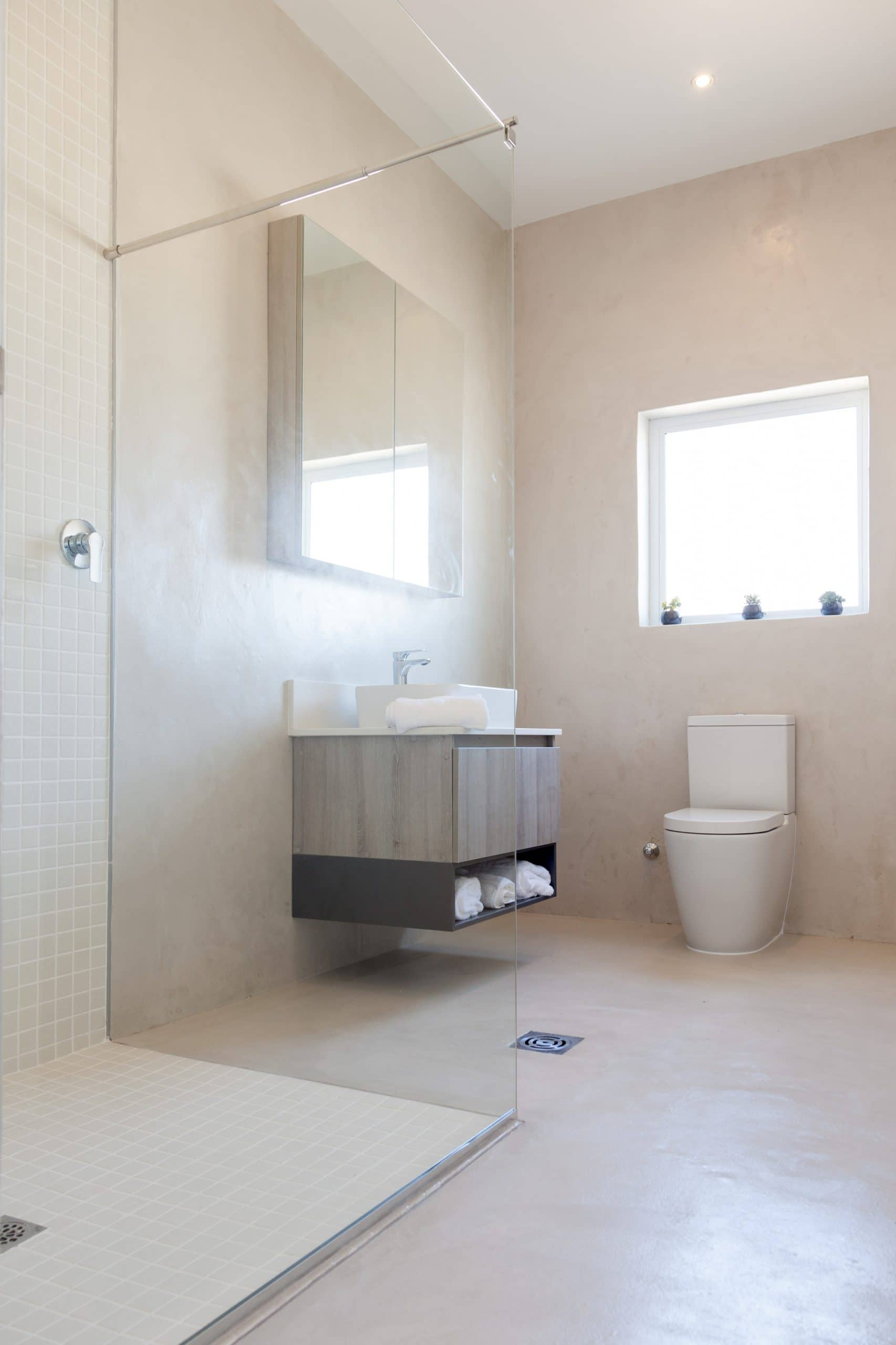 screed bathroom floors and walls with open showers