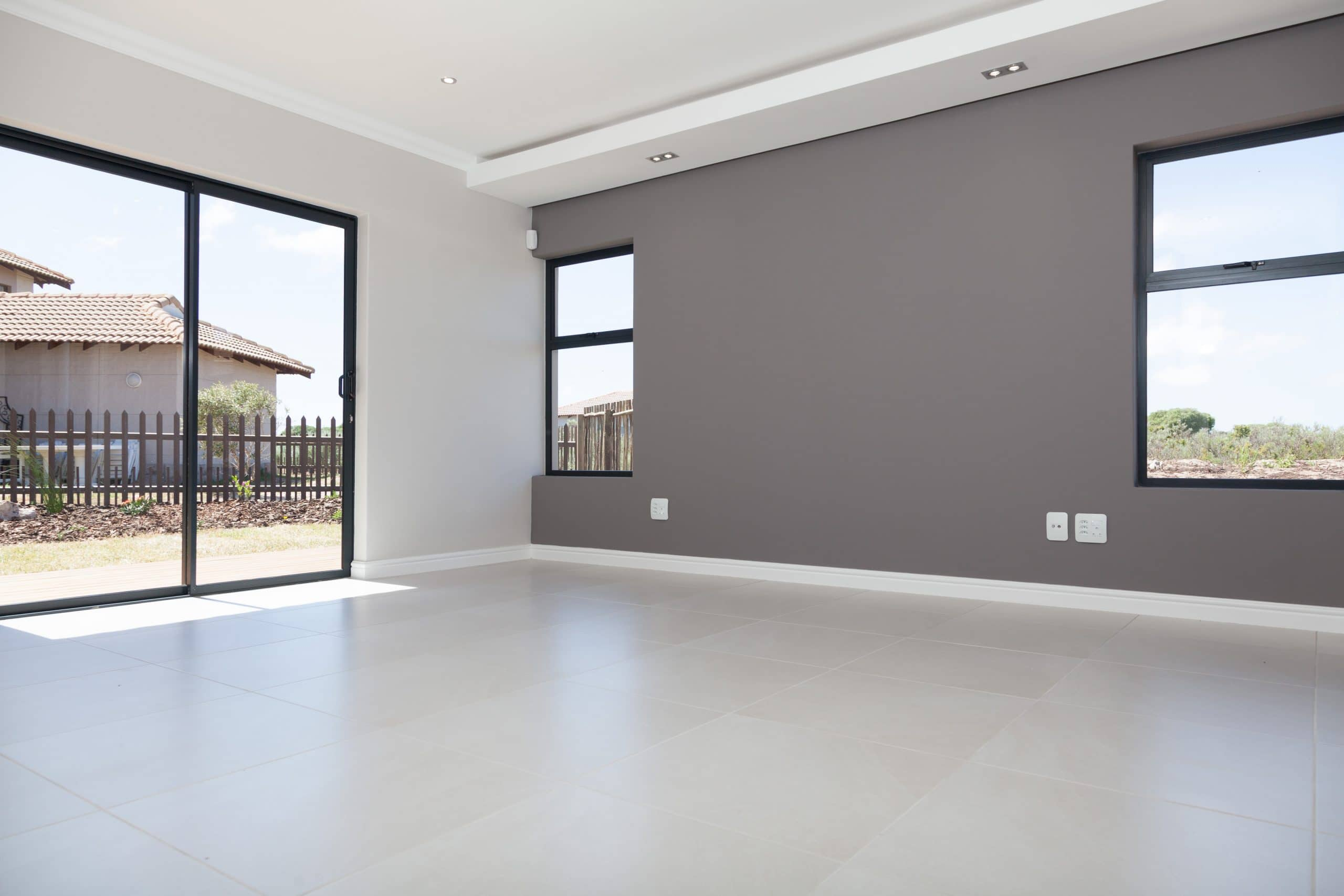 grey bedroom wall with bulkhead ceiling