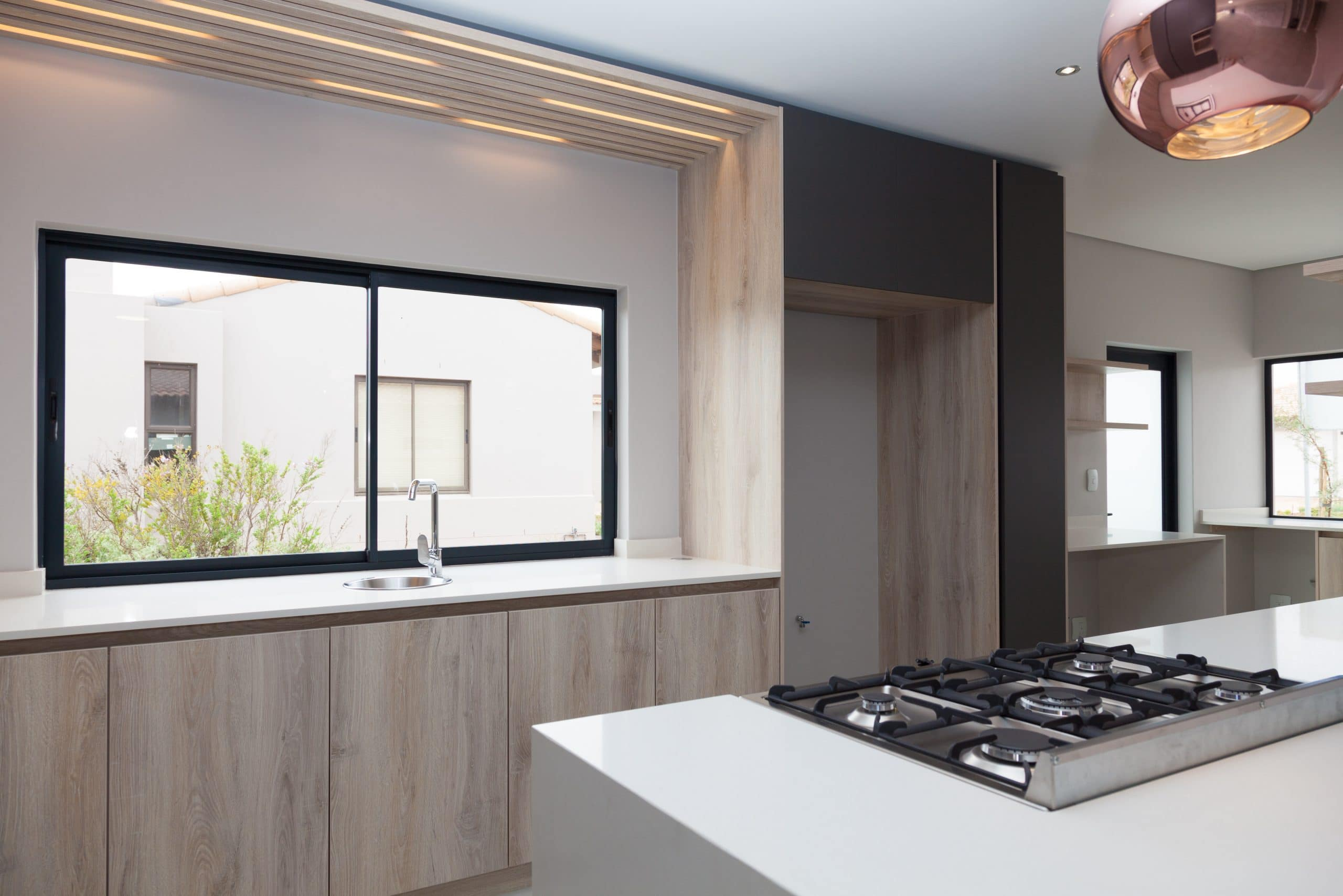 grey and wooden modern kitchen with led lighting