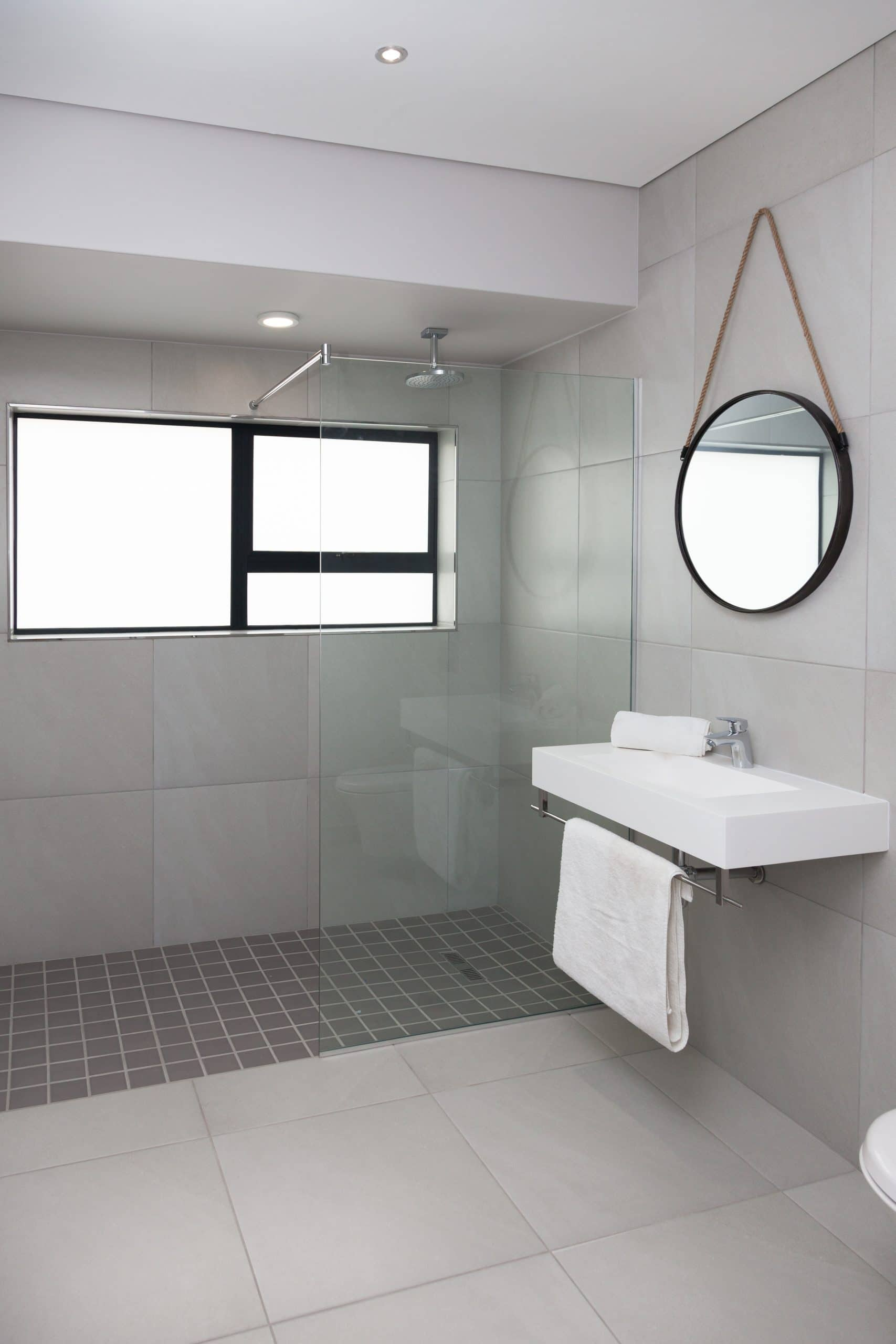 crystalite custom made wall hung basin with open shower