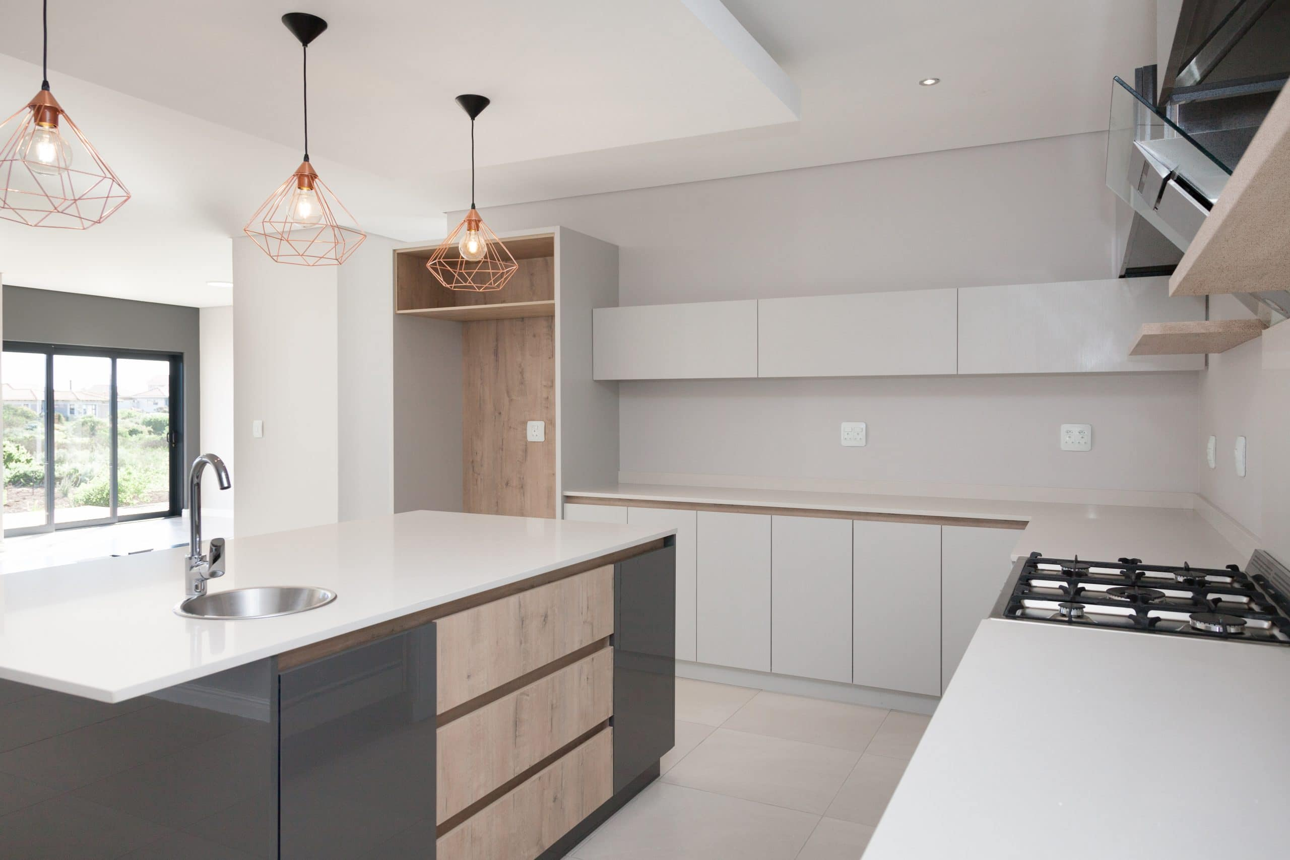 modern light dark grey with wooden kitchen and rose gold pendants