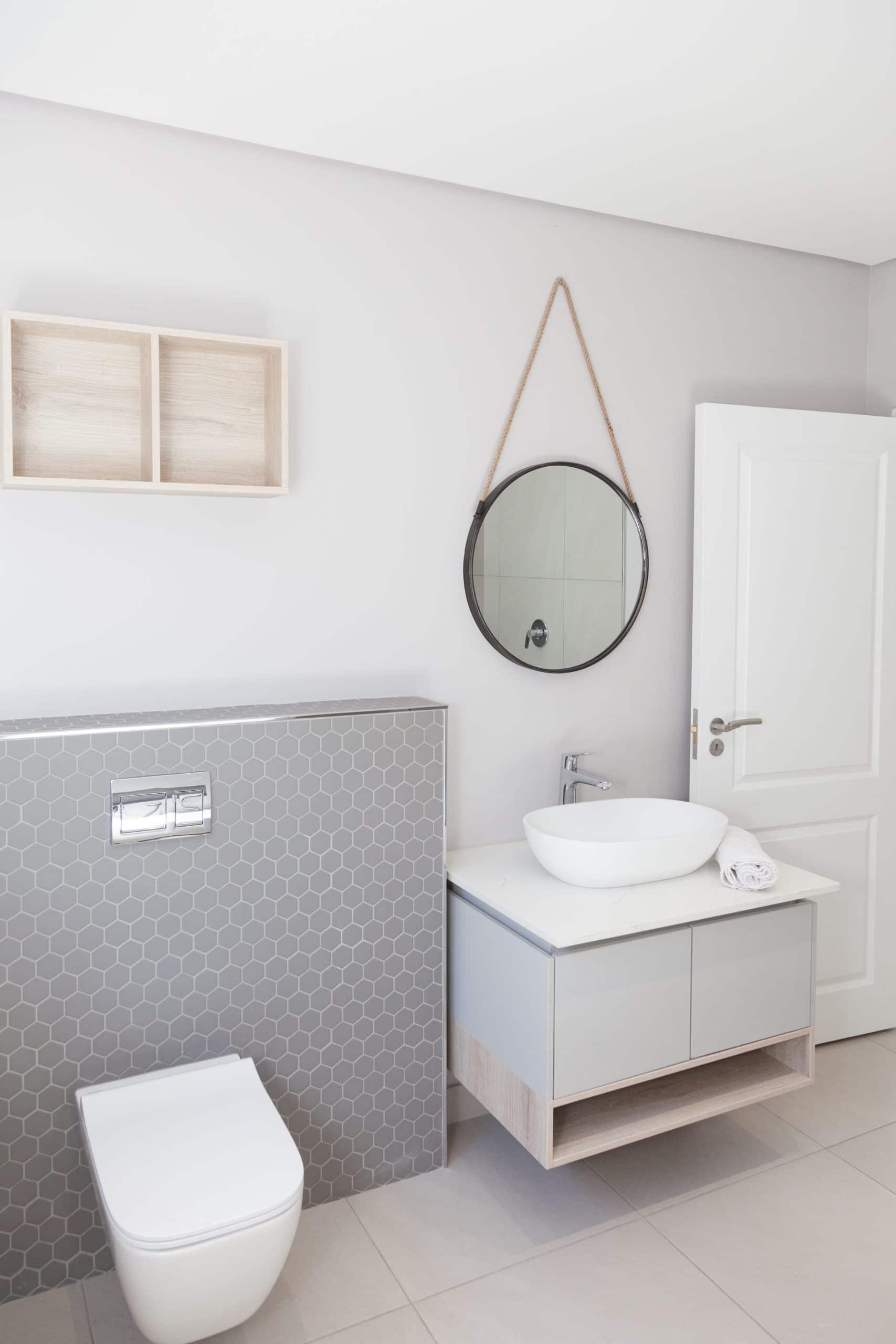 geberit wall hang cistern grey mosaics corricraft round mirror