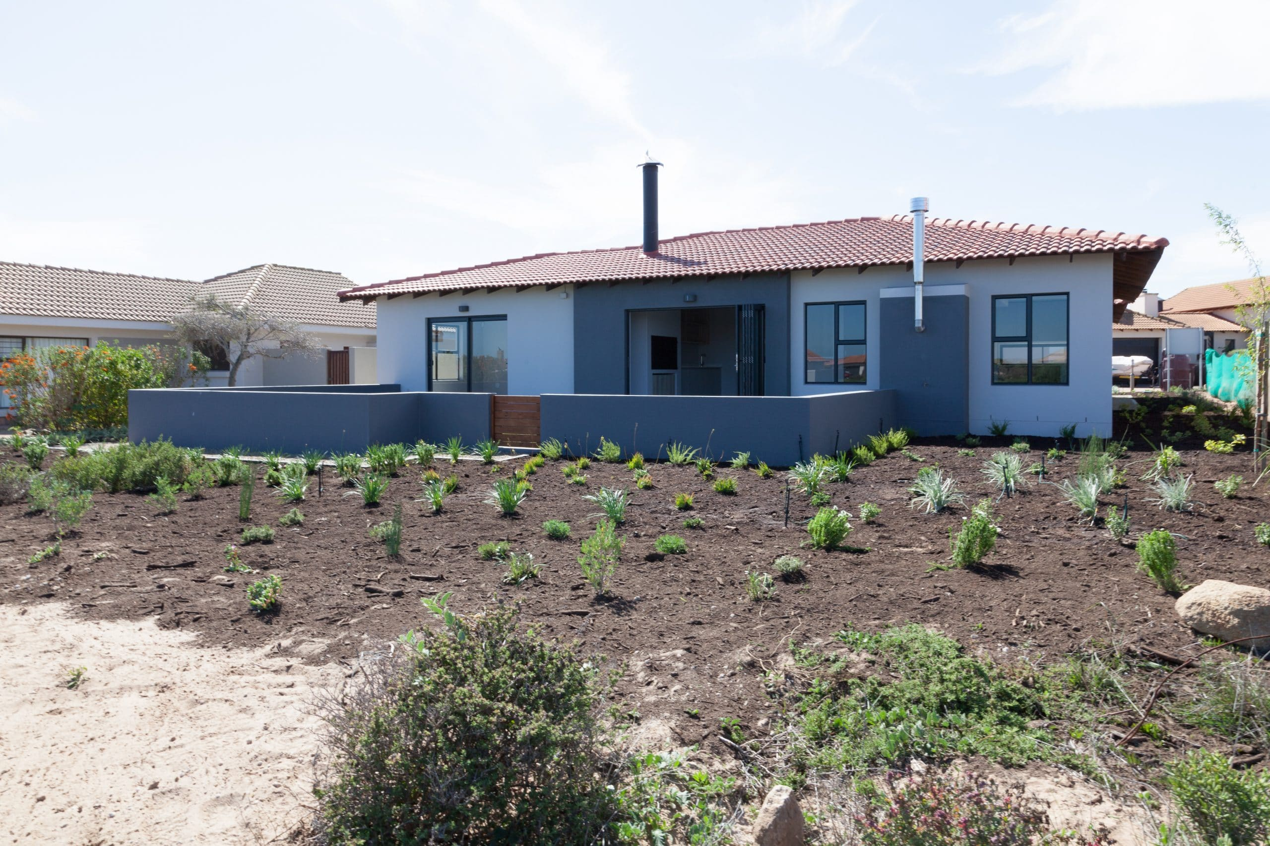 low wall enclosed yard with grass for small dogs in langebaan country estate