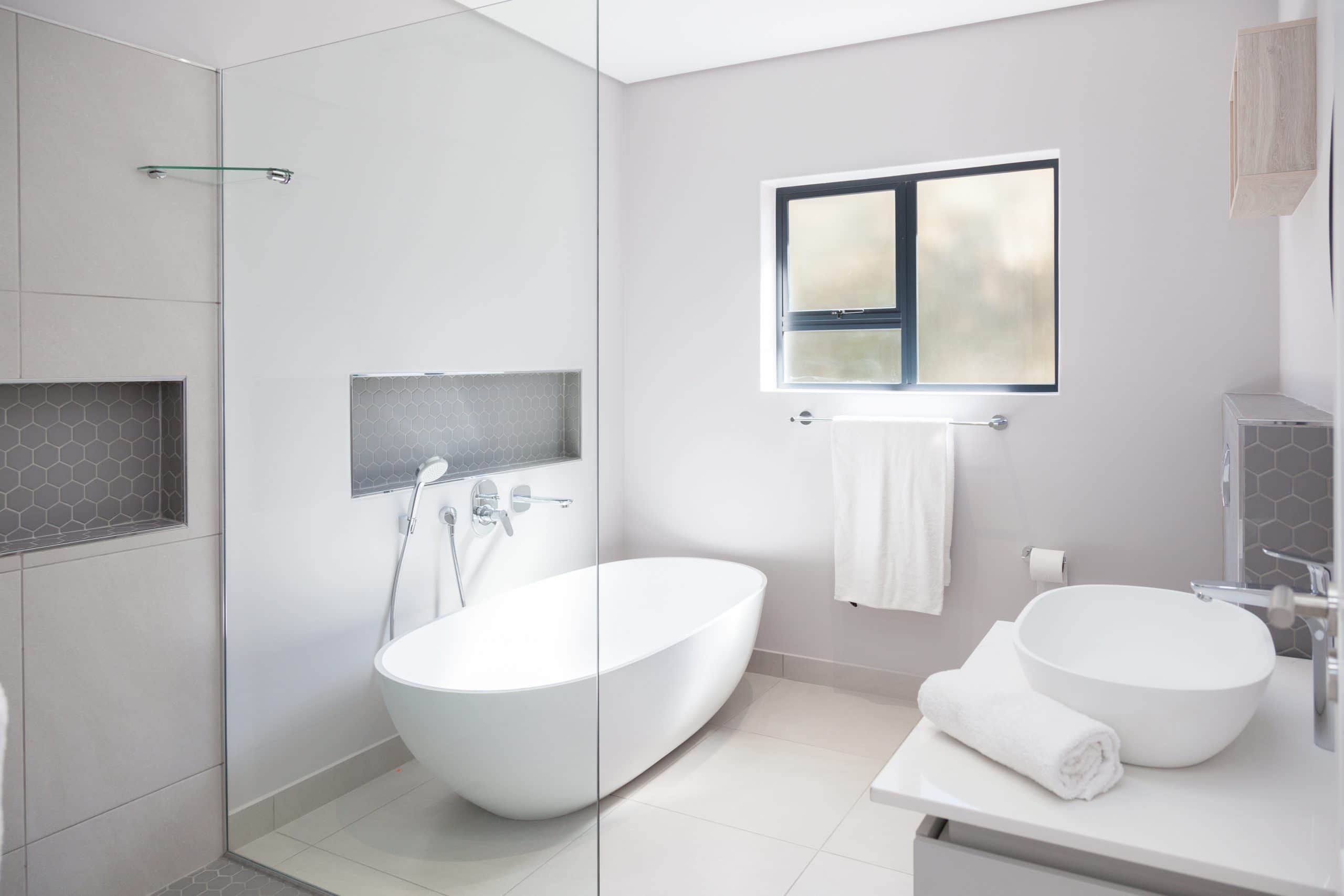 dado freestanding bath with open shower and modern bathroom