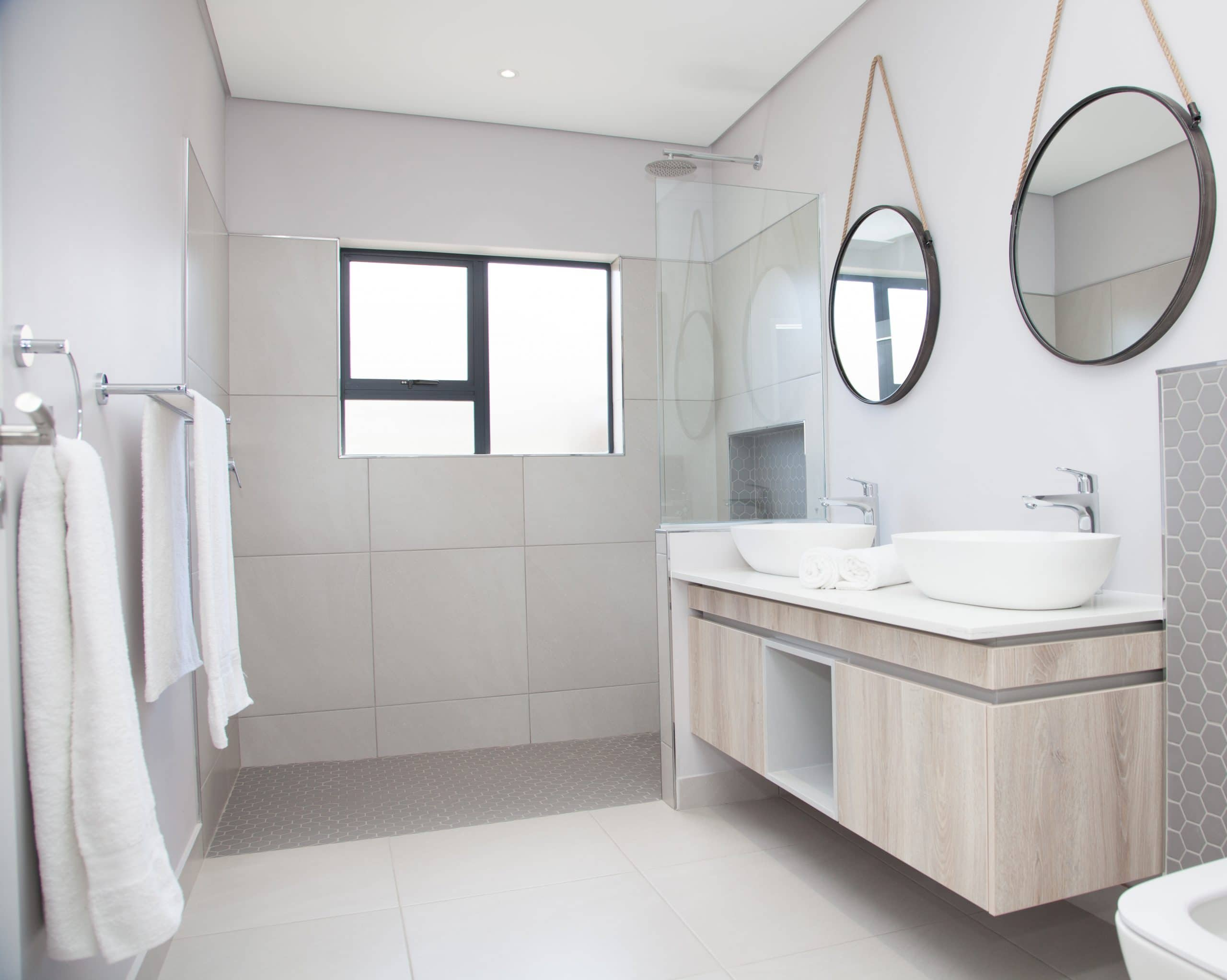coricraft round hanging mirrors with open shower