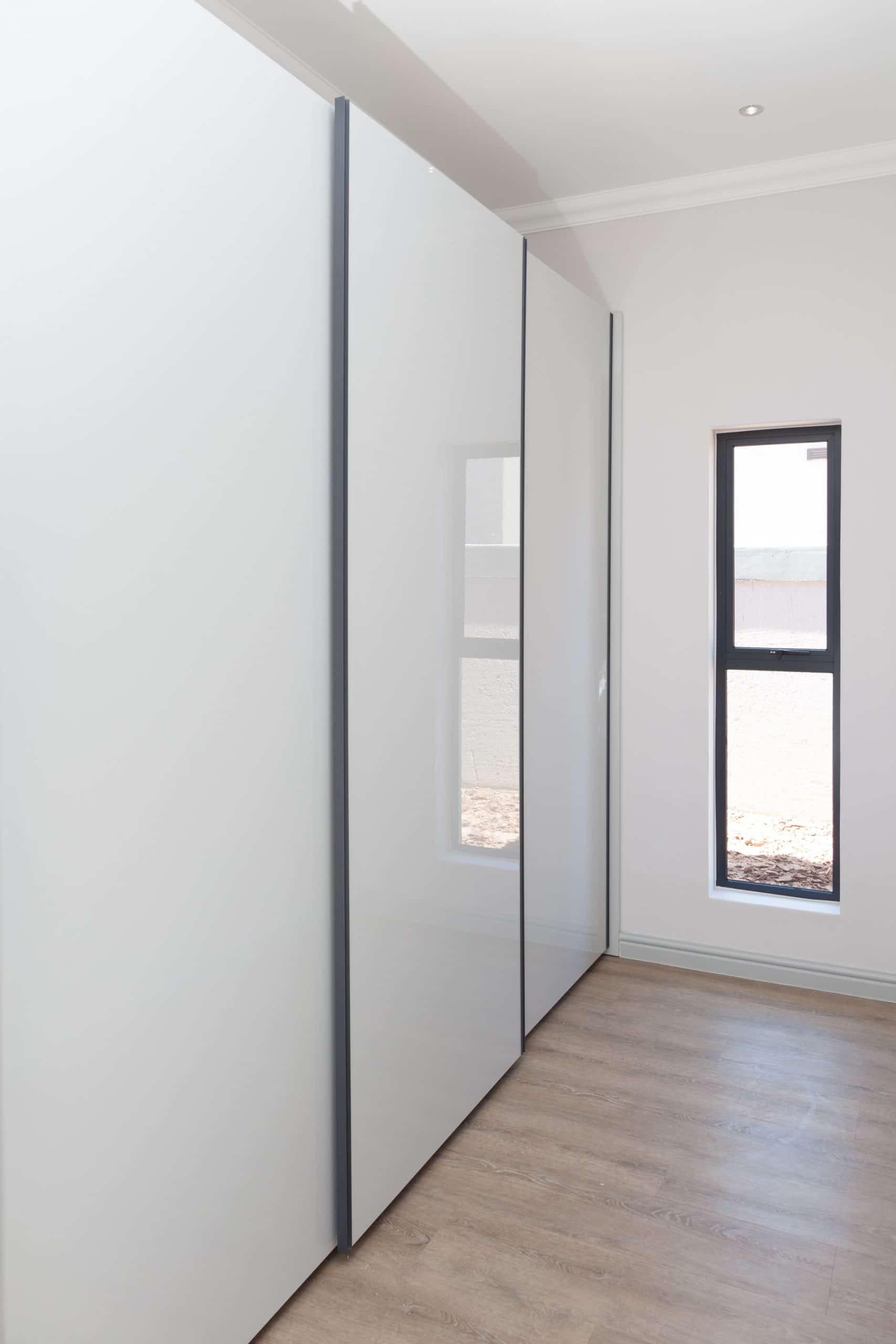 gloss bedroom sliding doors on wooden vynal flooring