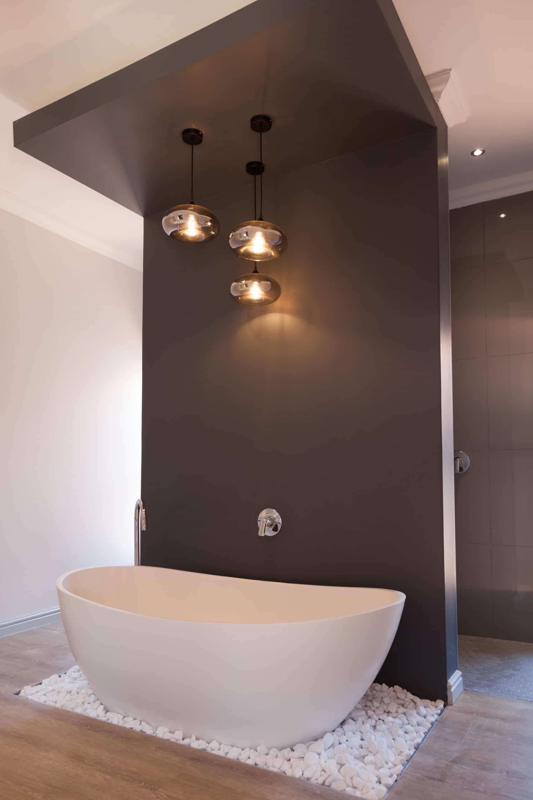 modern bath on white stone pebbles grey bulkhead bathroom glass pendants