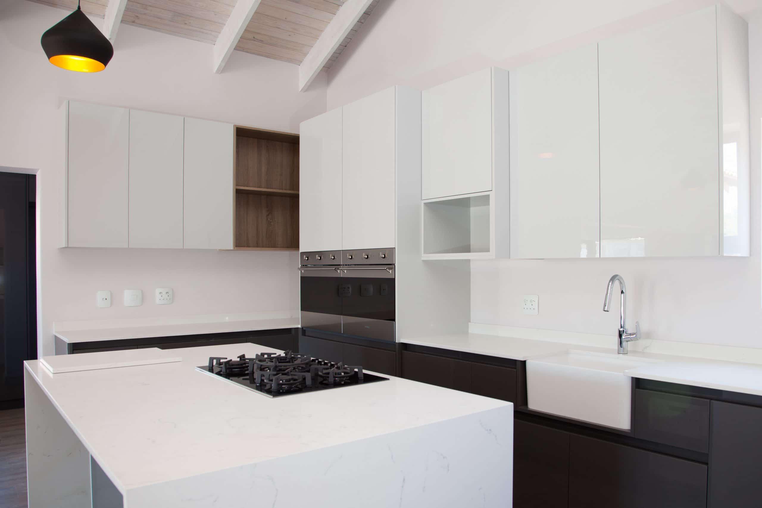modern light and dark grey ktichen on wooden flooring langebaan country estate