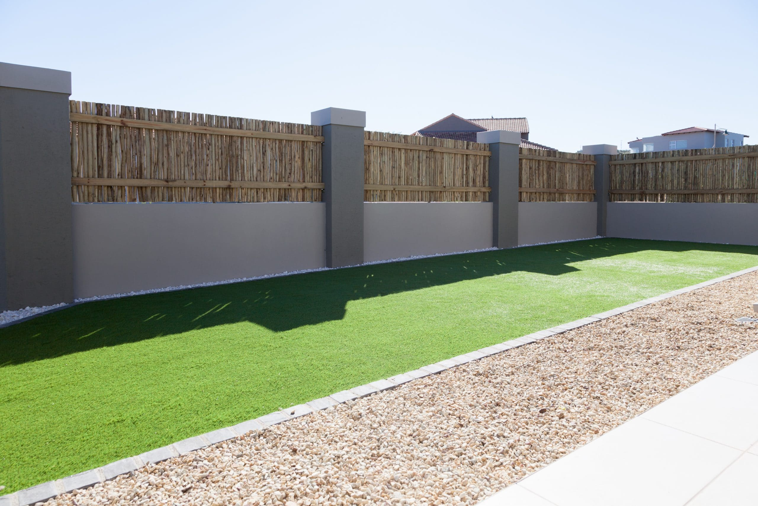 artificial lawn with aggregate and wattle fenced enclosement langebaan country estate