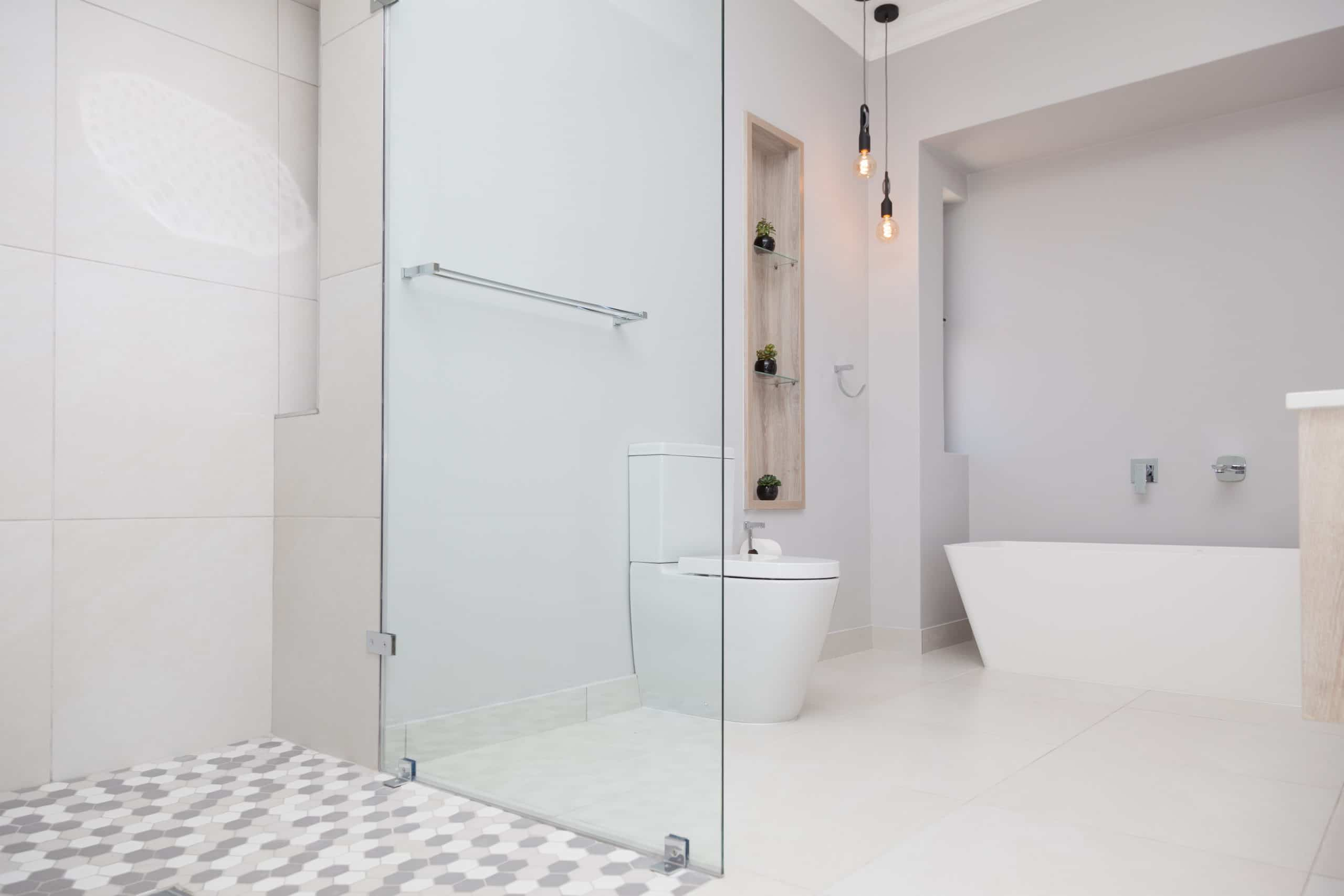 modern inlet bathroom shelve next to toilet with hanging pendants