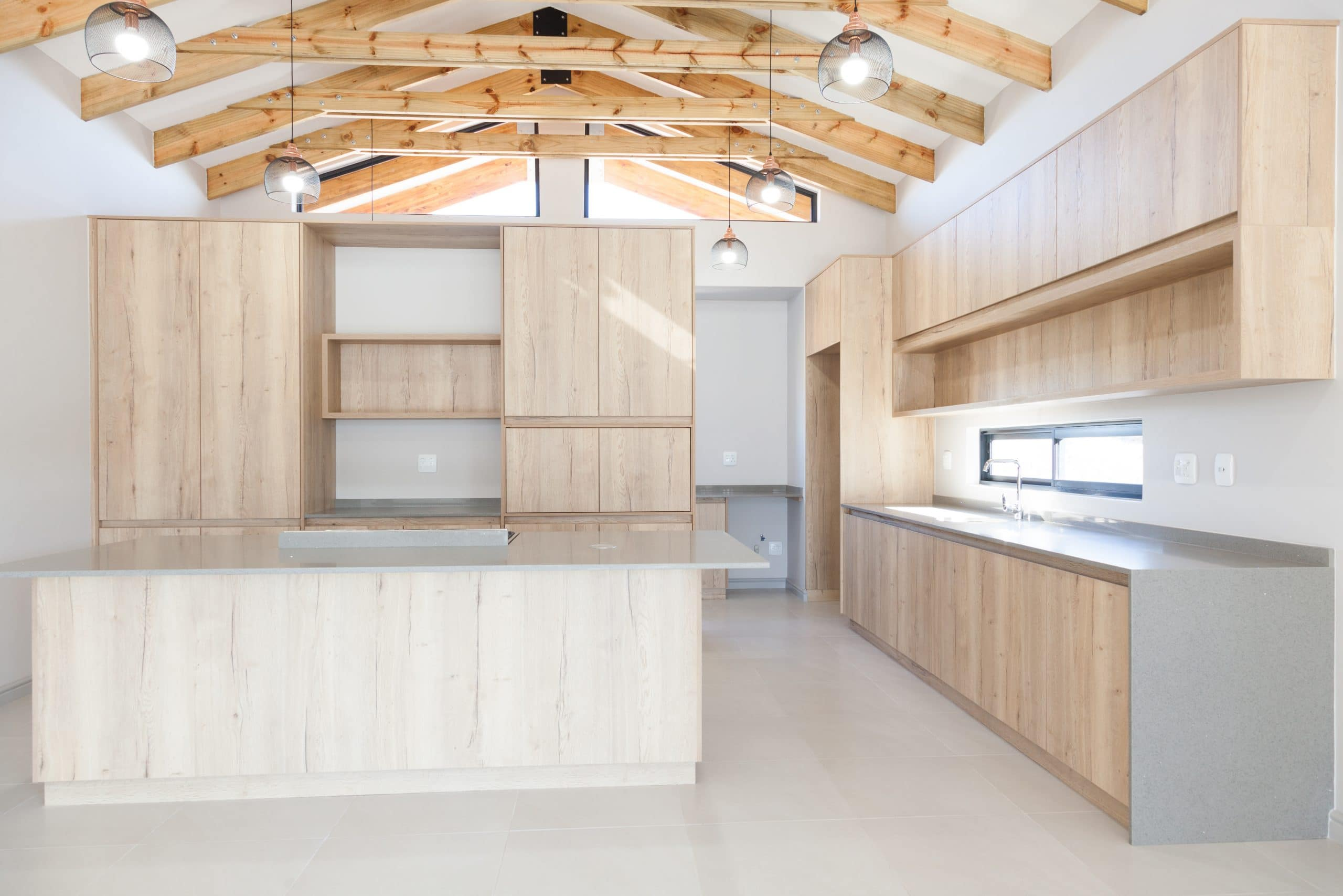 wooden exposed trusses modern kitchen grey counter tops