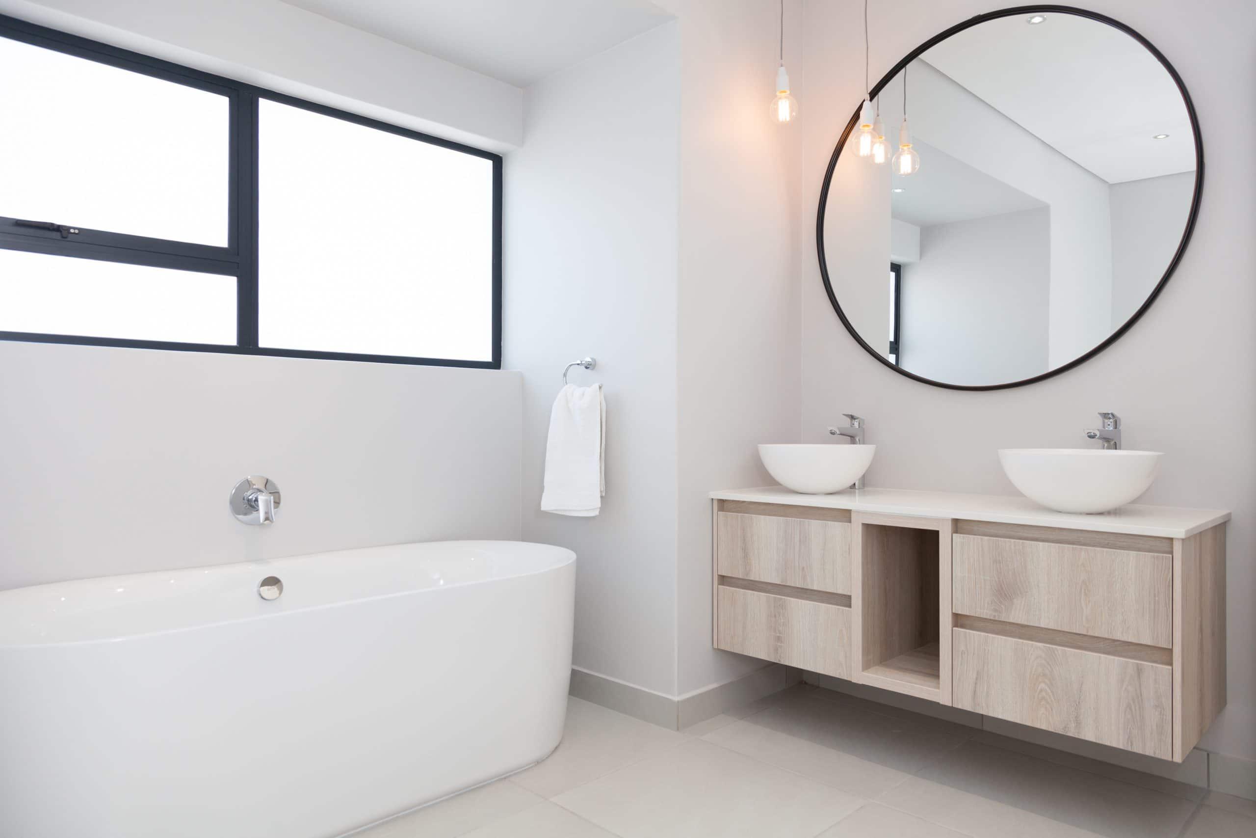 big round mirror with vanity bathroom