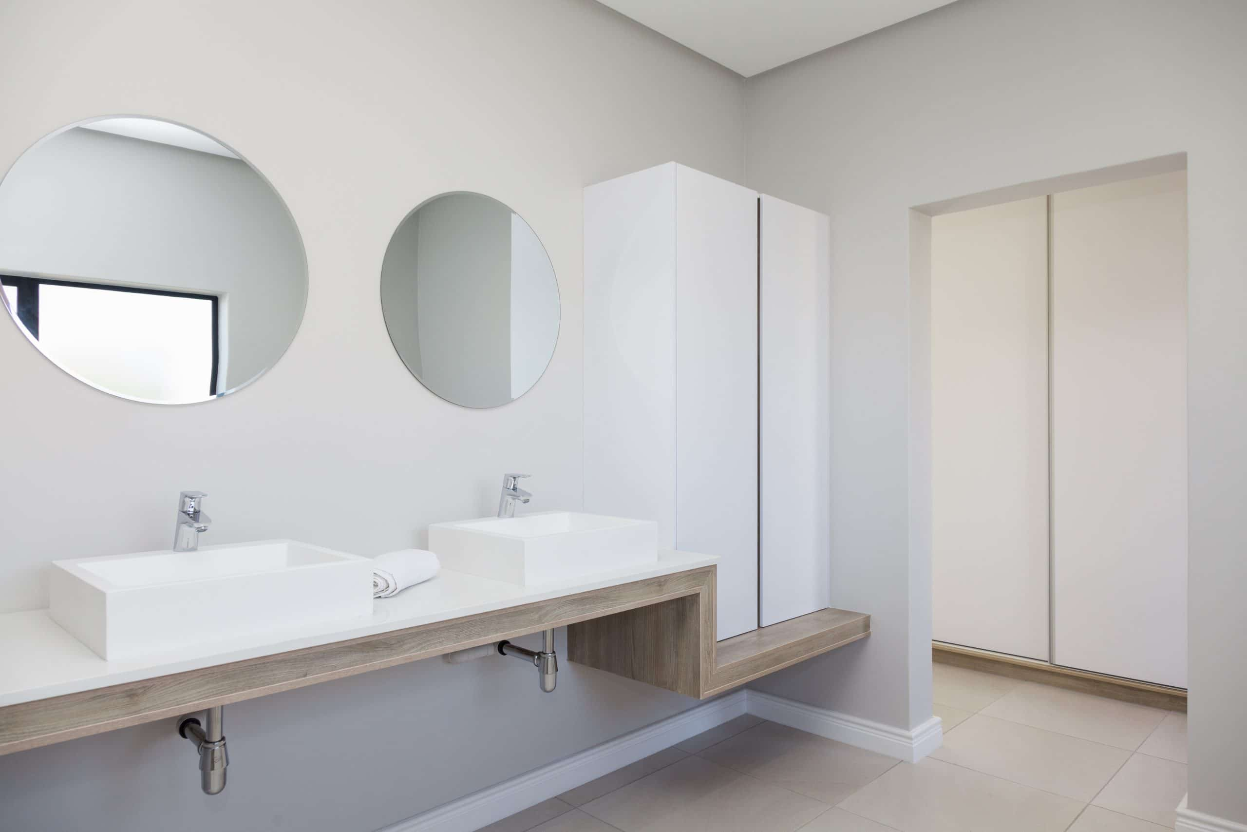 round ctm mirrors with floating bathroom vanity