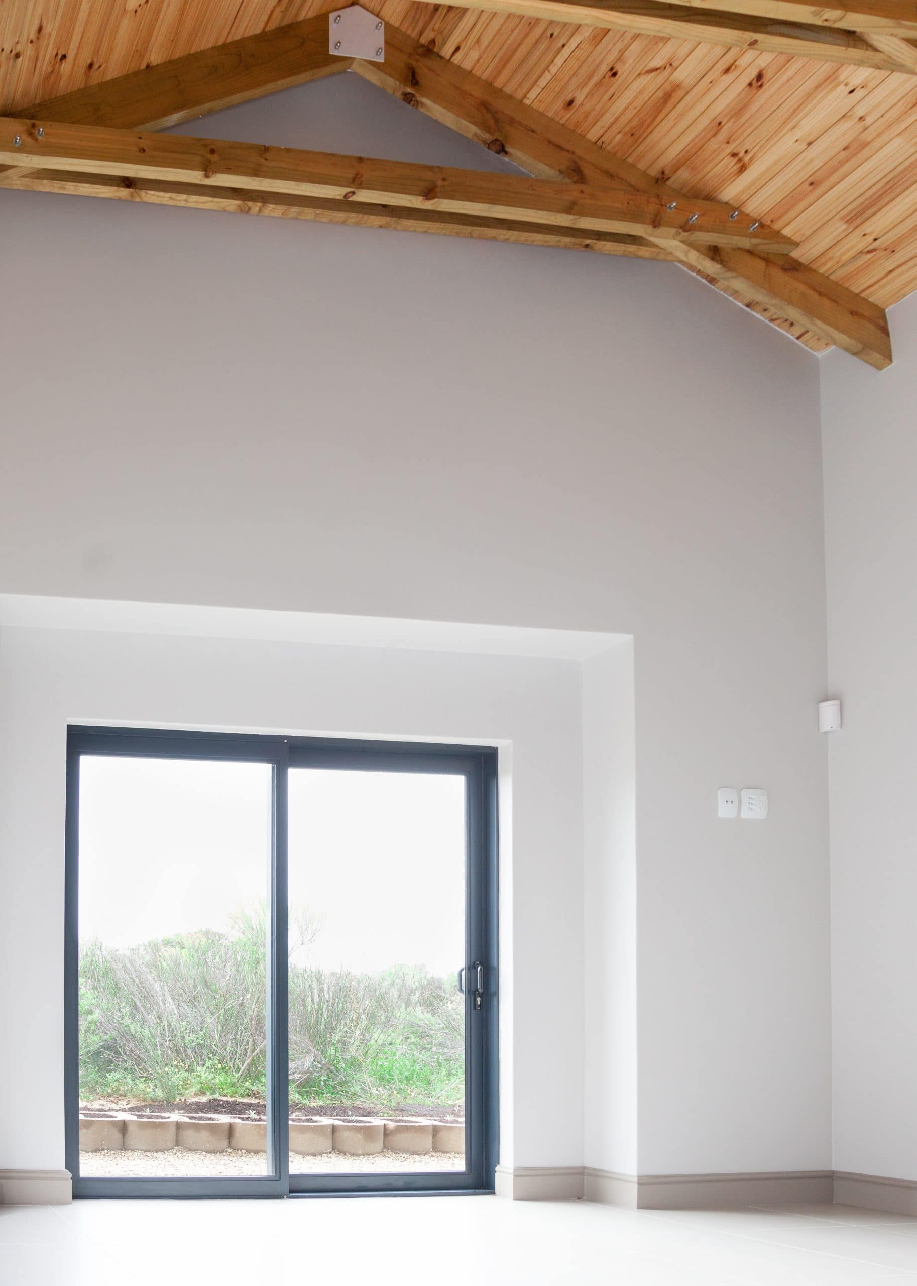 exposed open trusses bedroom in langebaan country estate