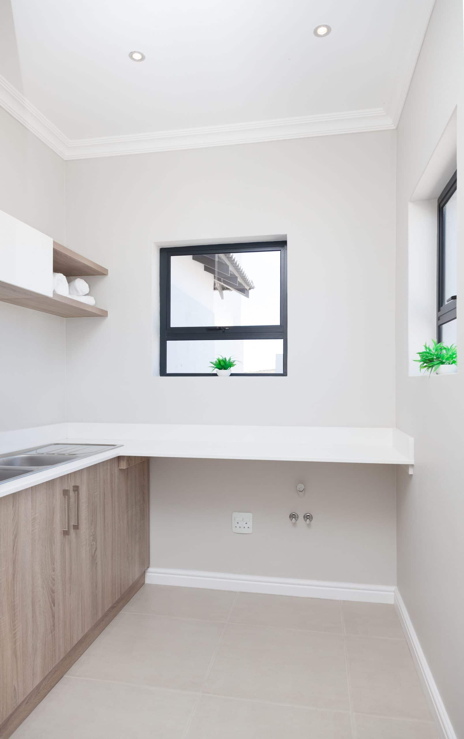 modern scullery light and bright white cupboards