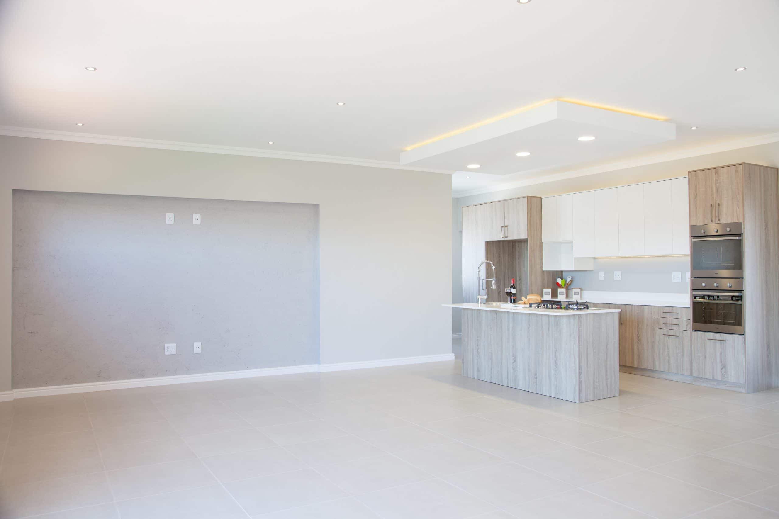 modern white and wood kitchen with bulkhead