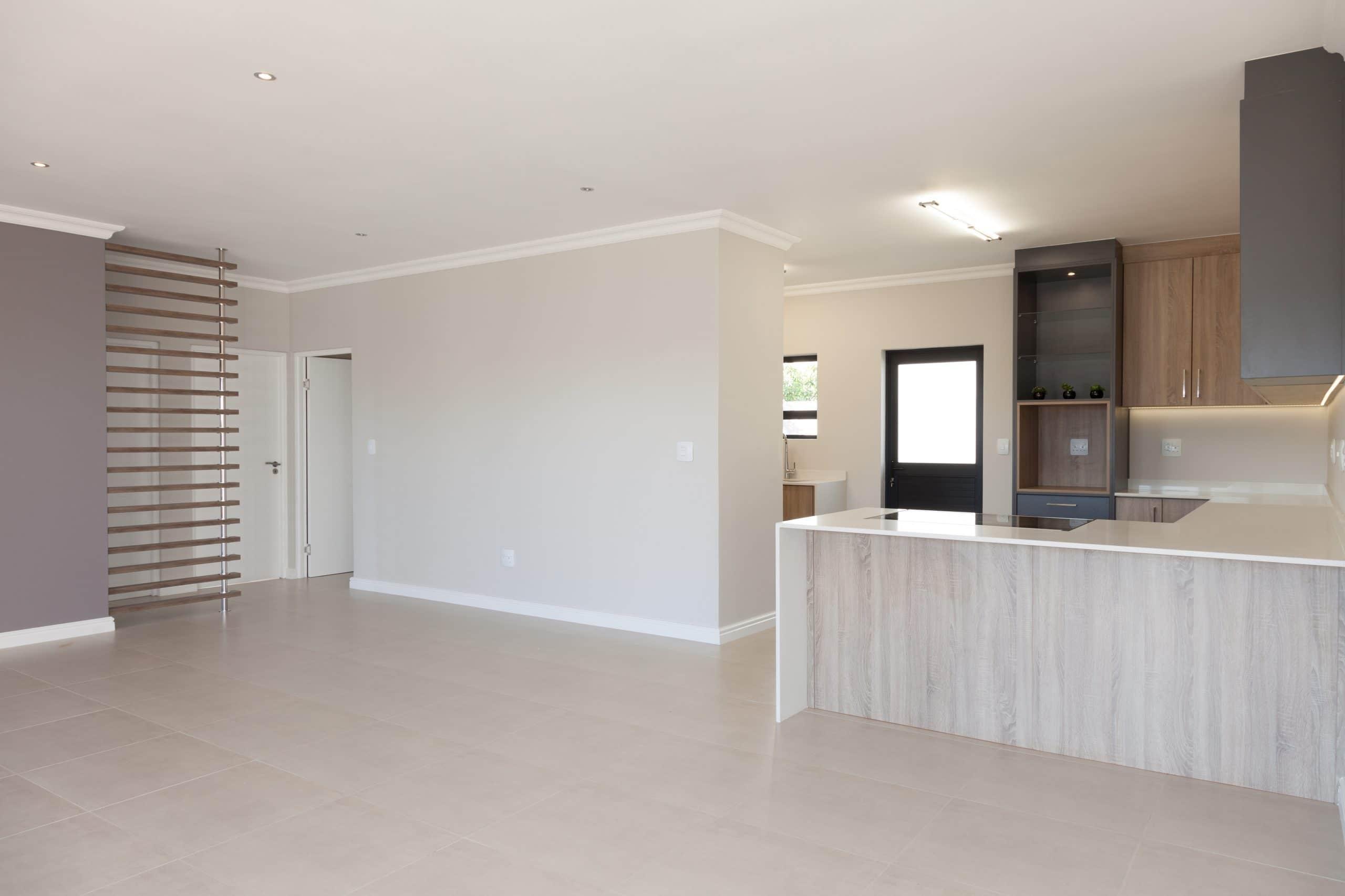 living room divider wooden slats stainless pole modern kitchen langebaan