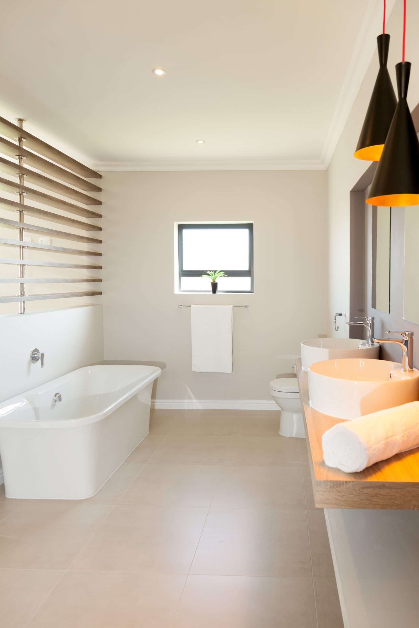 modern freestanding bath in tiled floor