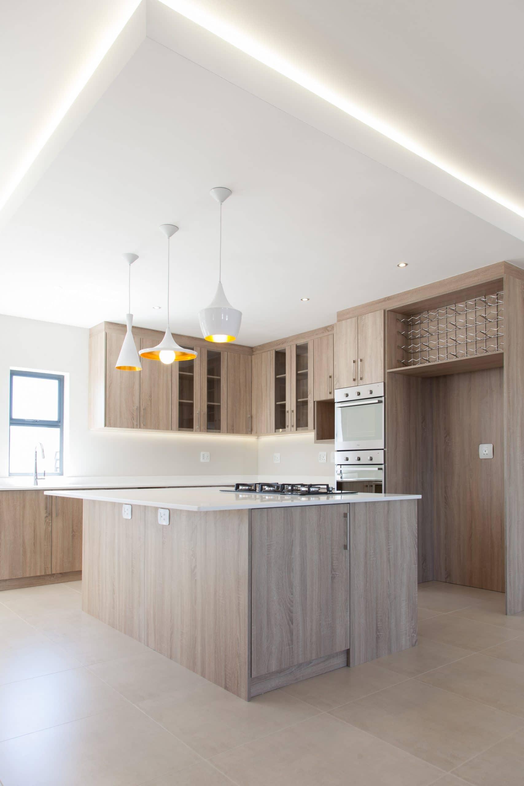 led bulkhead over modern kitchen