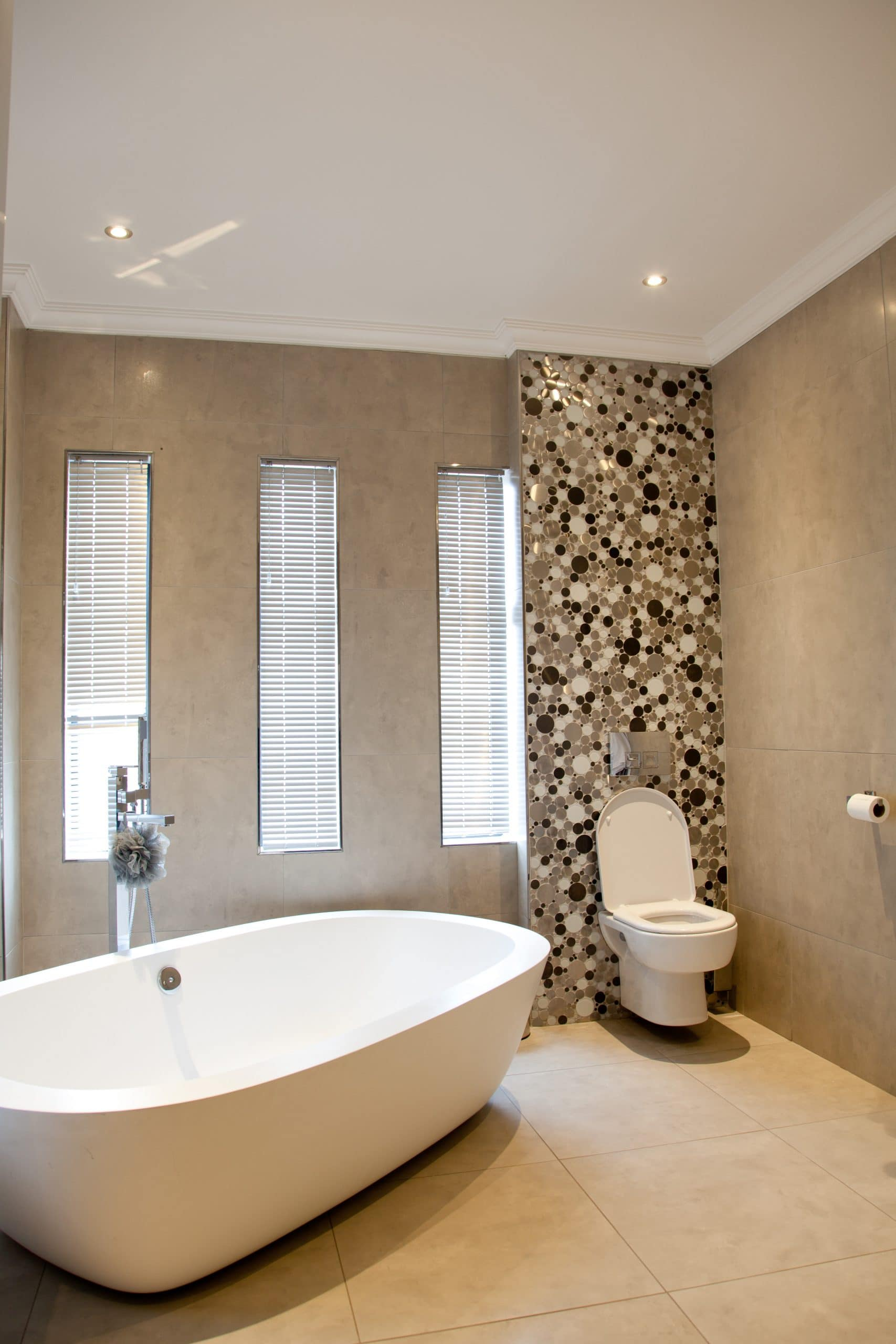 modern bathroom tiled and mosaic freestanding bath