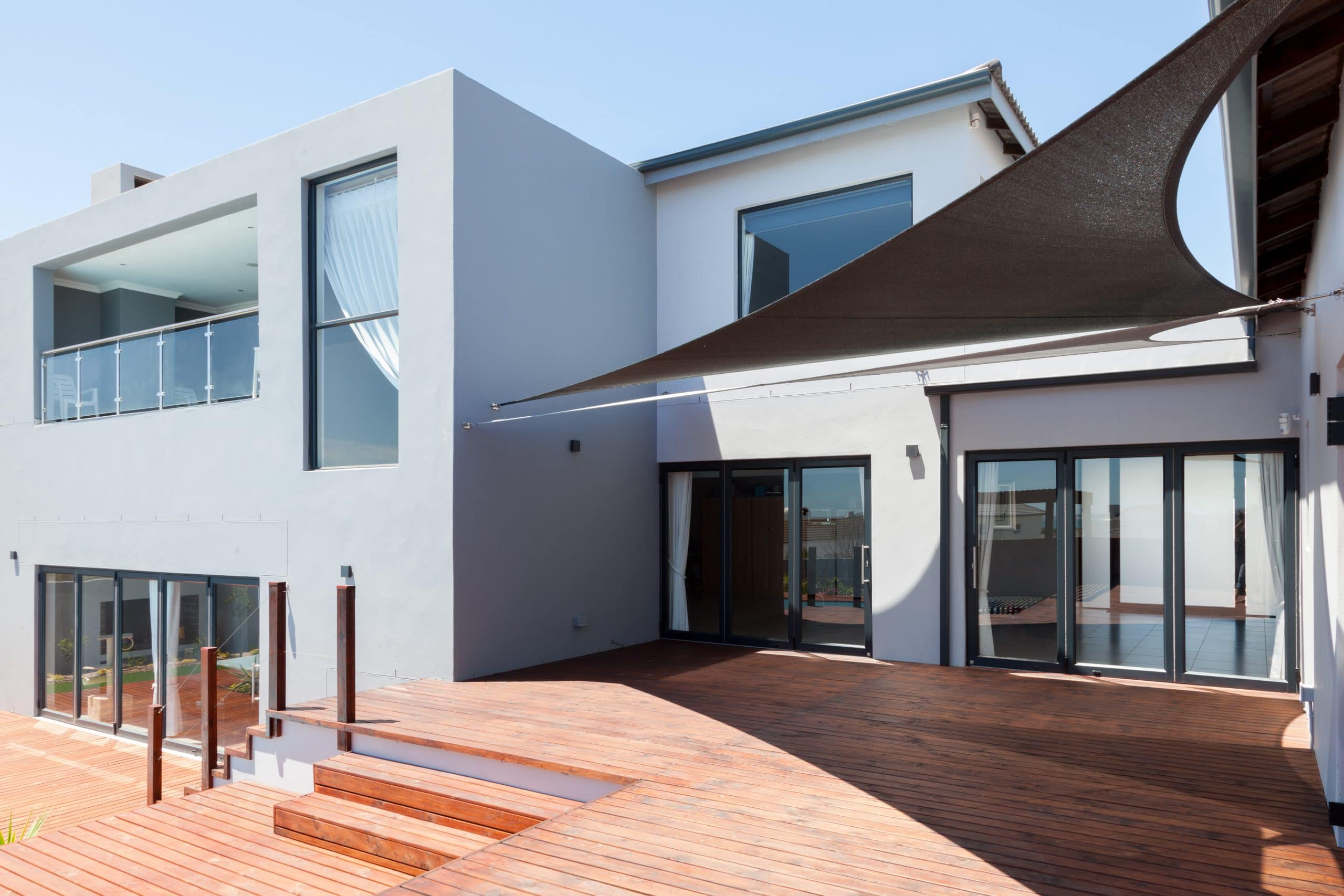 modern design grey house in langebaan with timber wooden decking