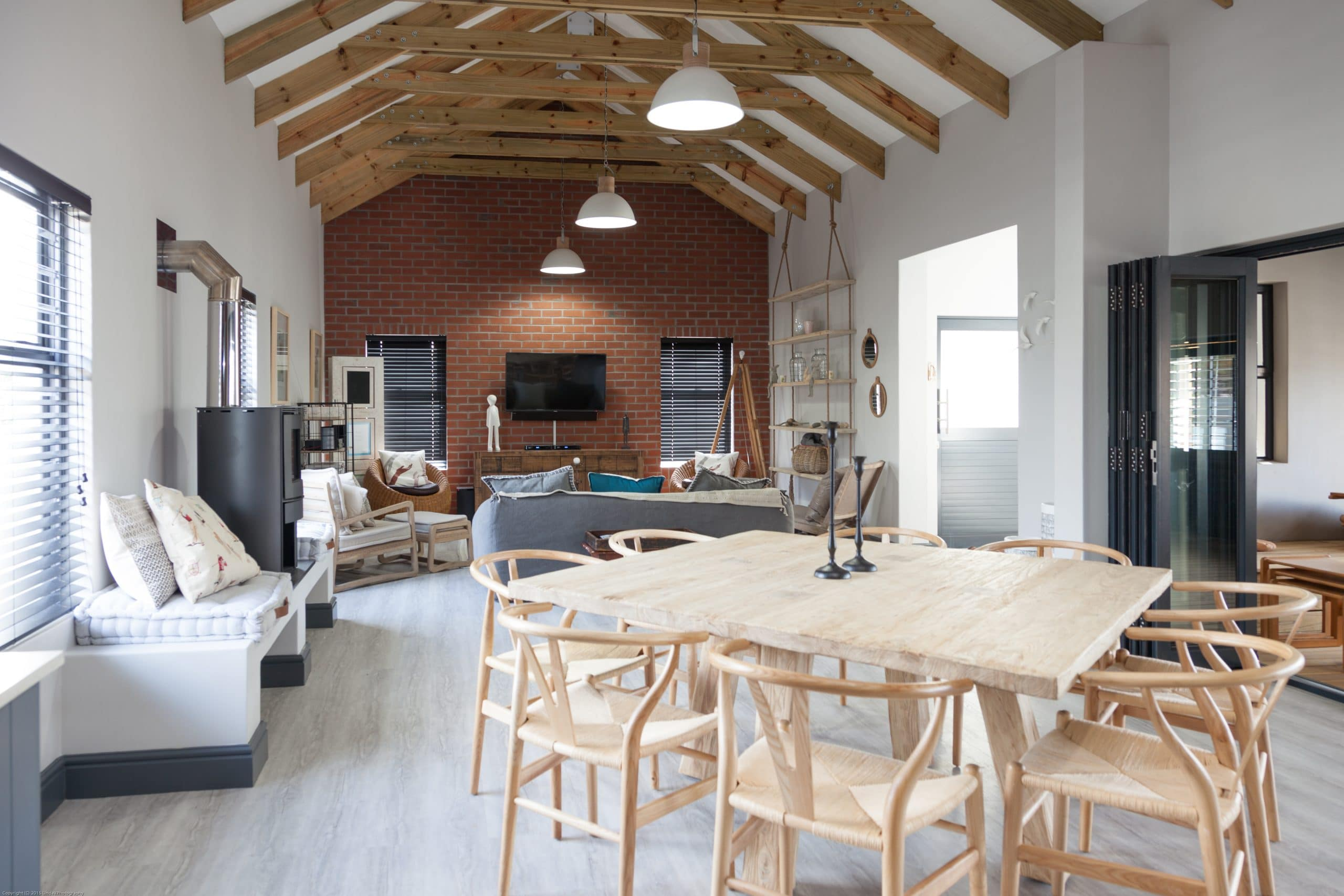 red brick wall exposed timber roofing coricraft furnished