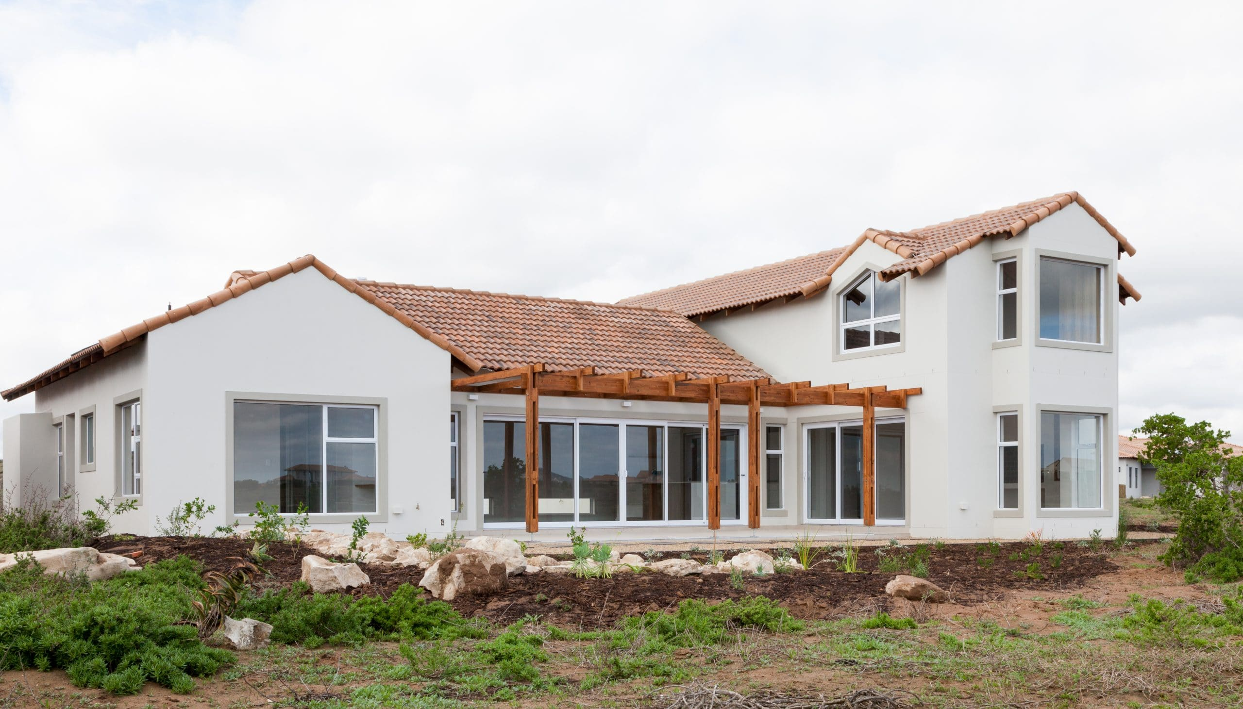 Swedish design home in langebaan country estate with wooden pergola tiled roof