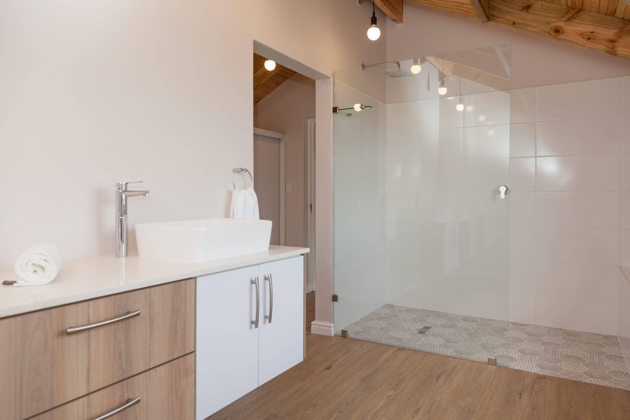 stiles styles shower flow with white wooden vanities open shower