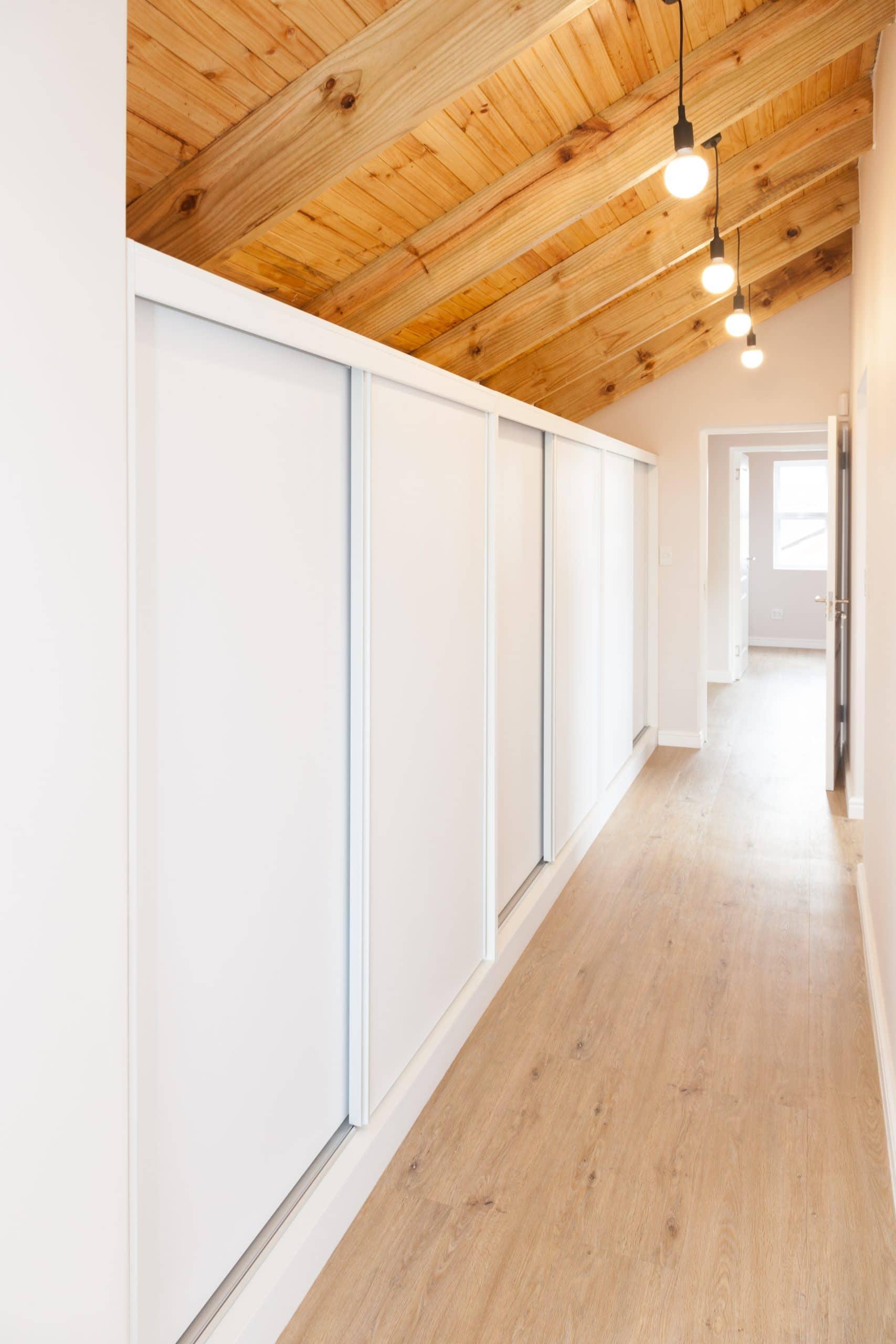 open trusses loft bedroom sliding cupboards wood flooring