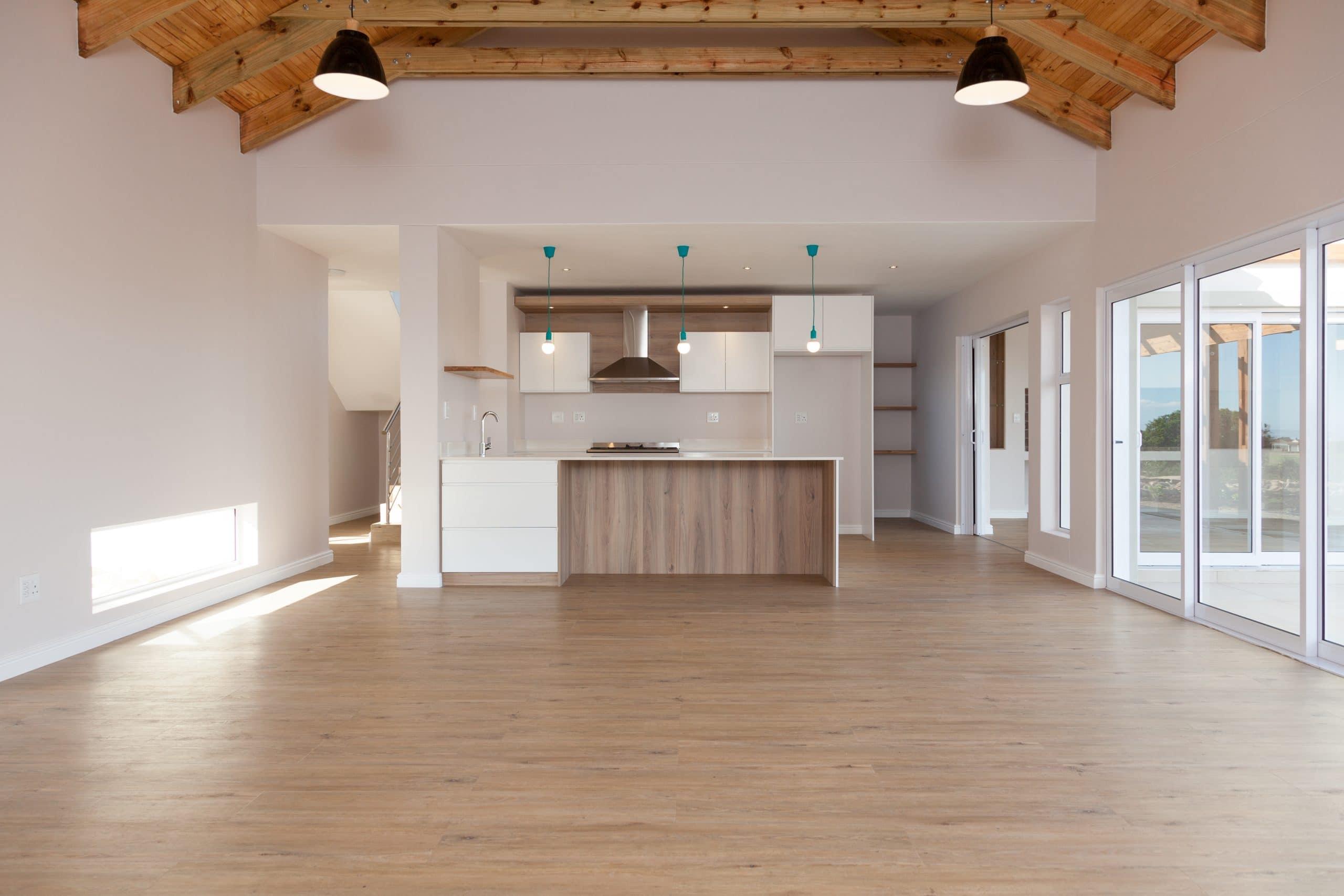 wooden flooring exposed open trusses Scandinavian designed kitchen living room