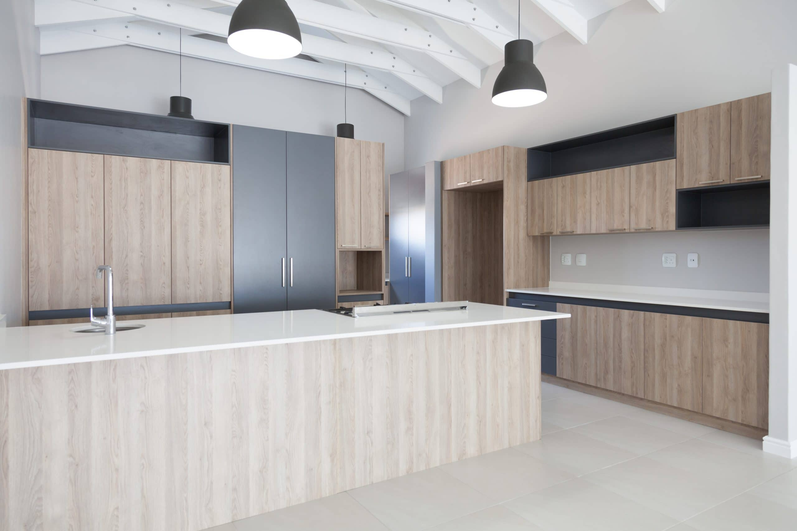 modern large grey and wooden kitchen with open trusses