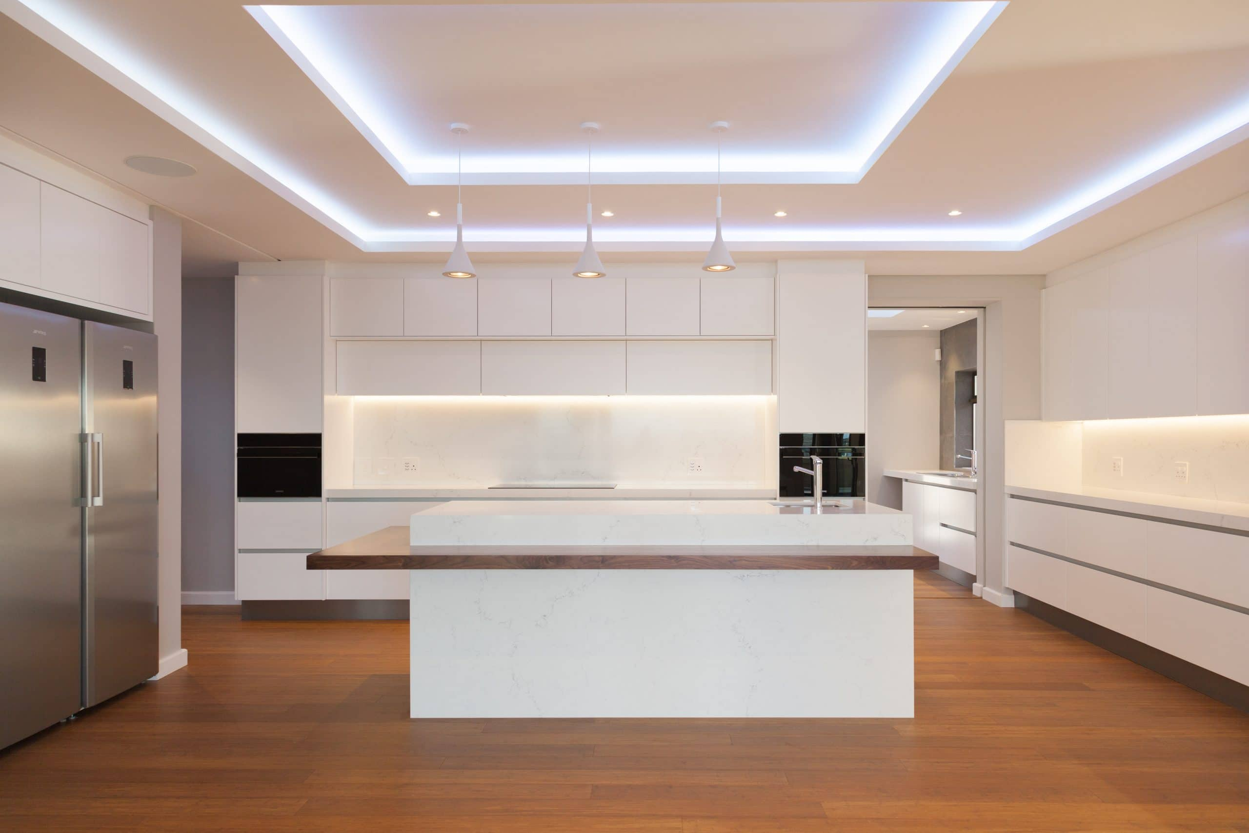 led bulkheads above white kitchen with smeg appliances