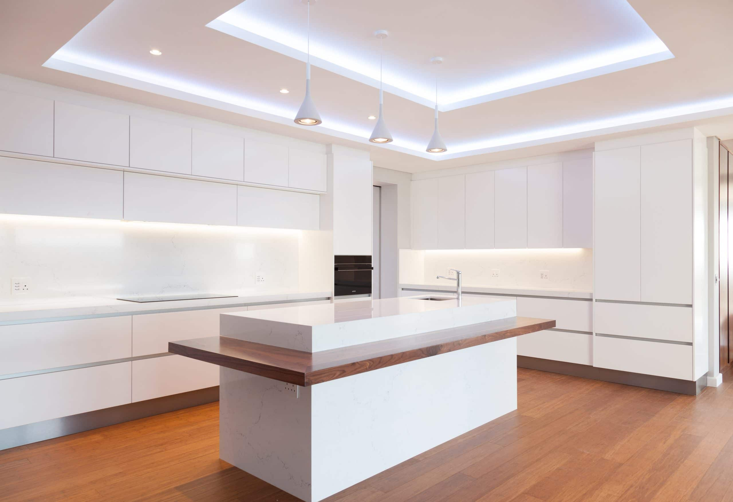 white led bulkheads kitchen with wood flooring and smeg appliances