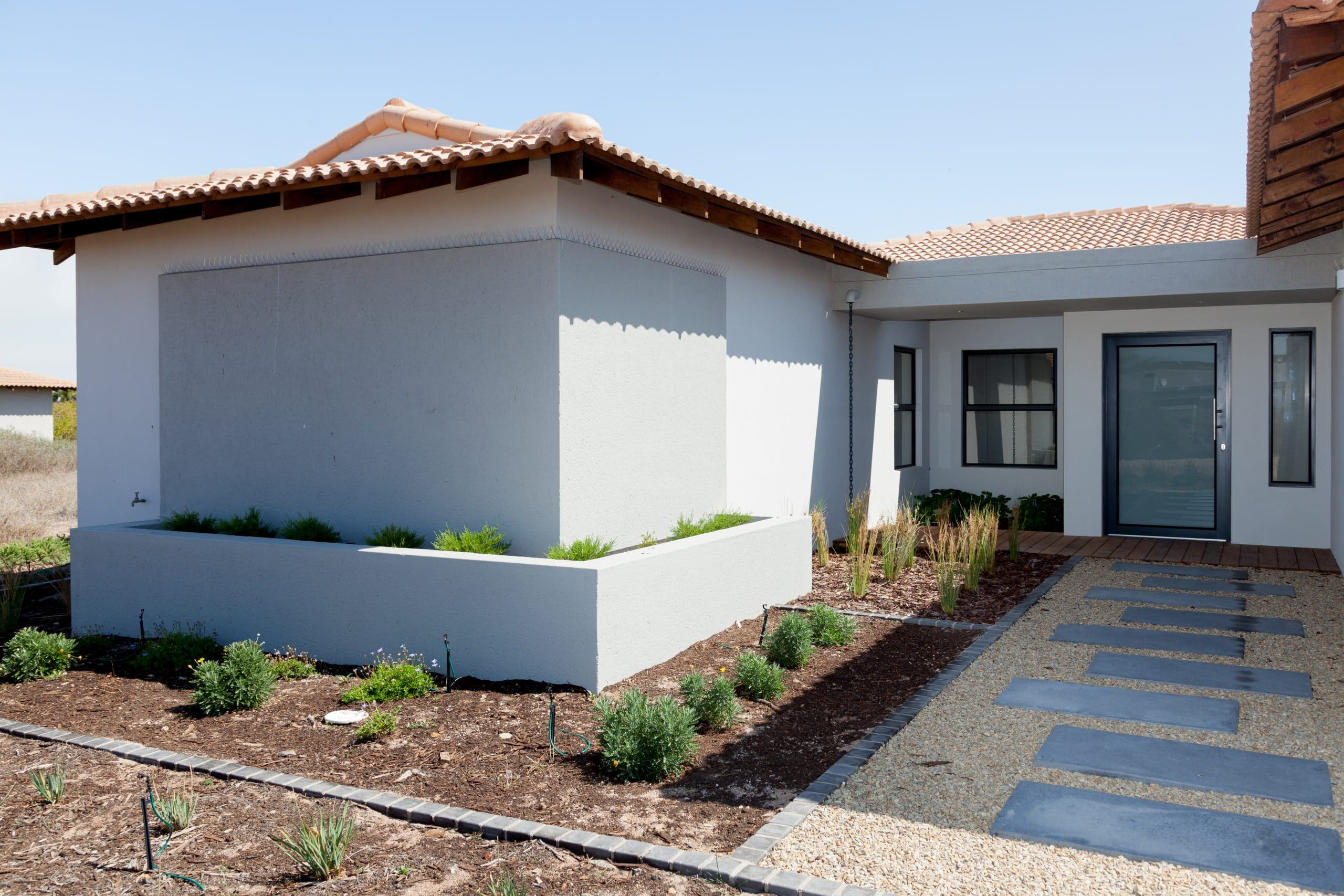 corner flowerbox with landscaped entrance langebaan country estate