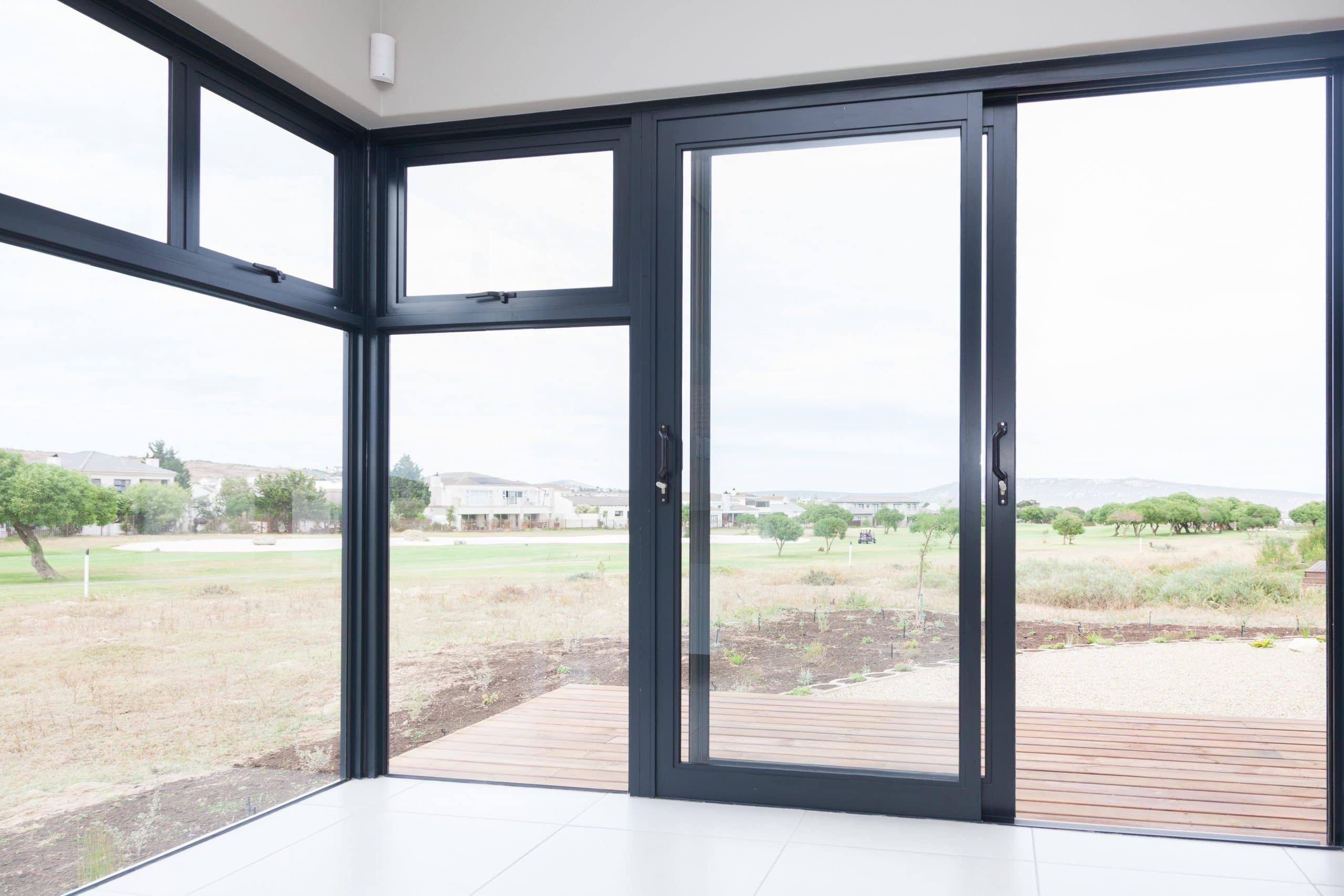 corner floor to ceiling window overlooking langebaan country estate build by crontech consulting