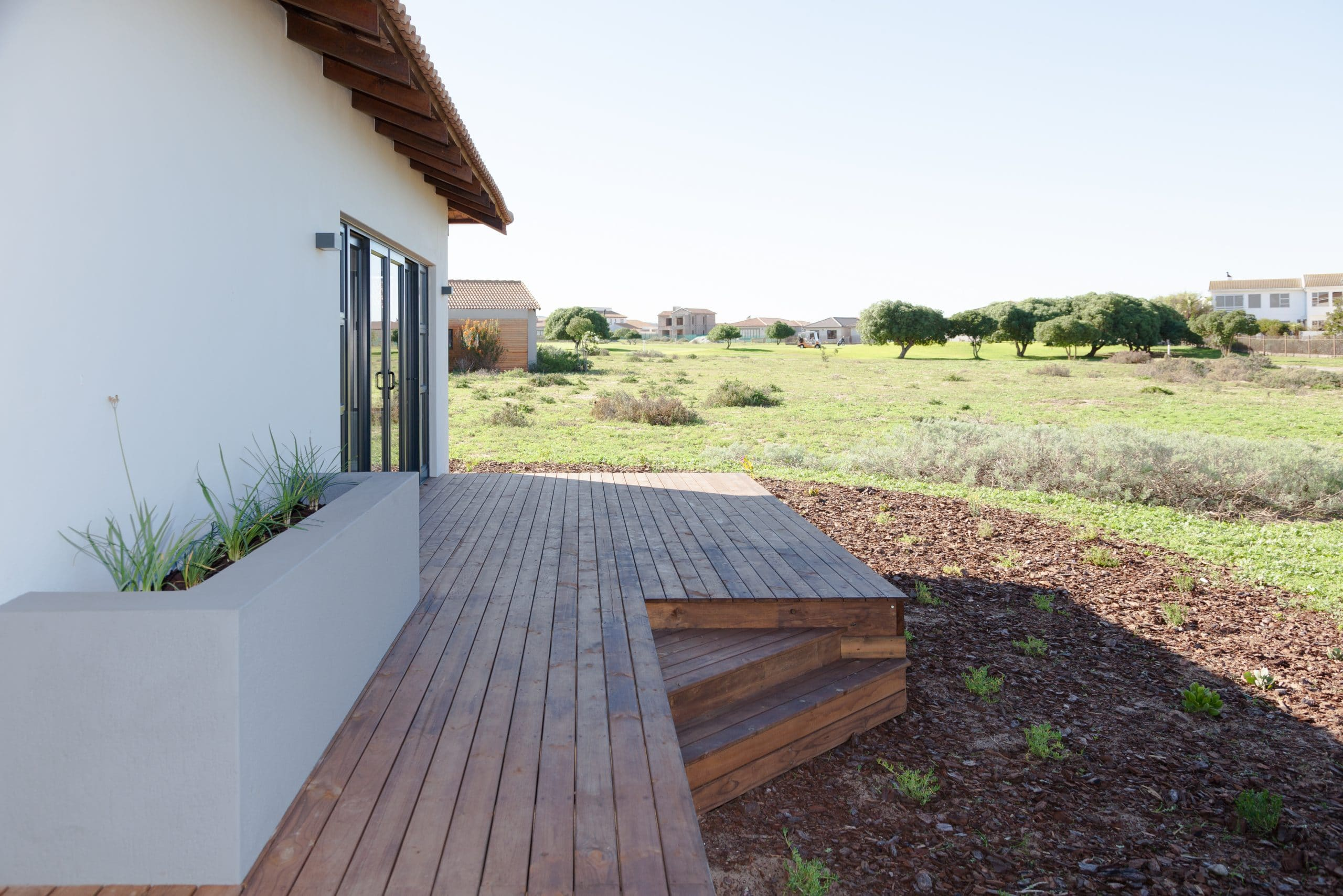 wooden timber decking overlooking golf course with flowerbox
