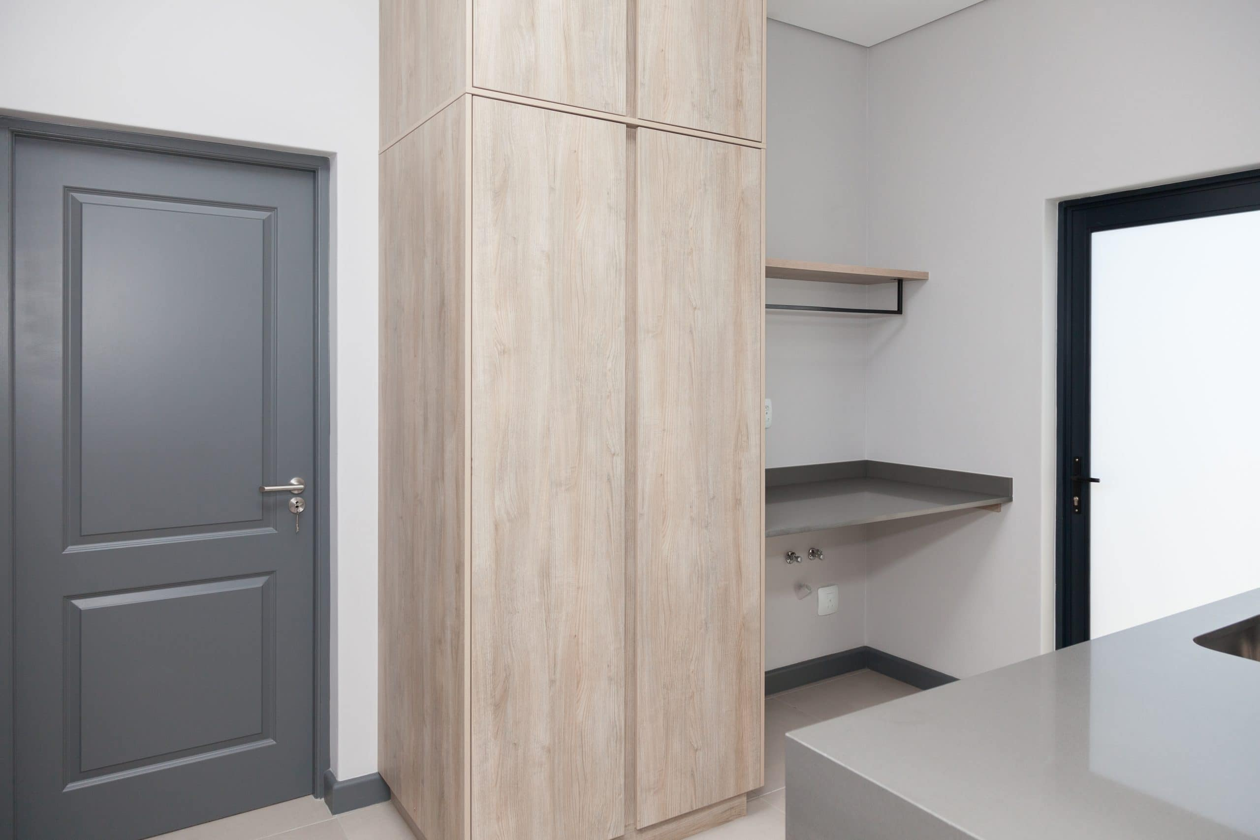 grey interior door with wooden scullery cupboards langebaan