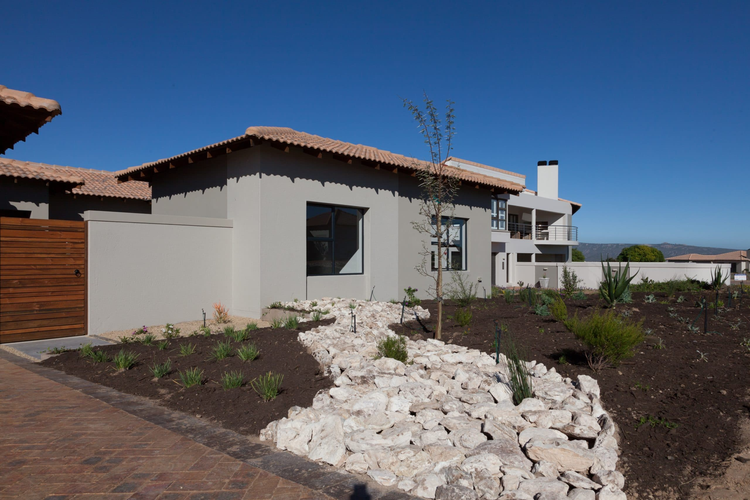 designer garden with white rock and tree langebaan country estate