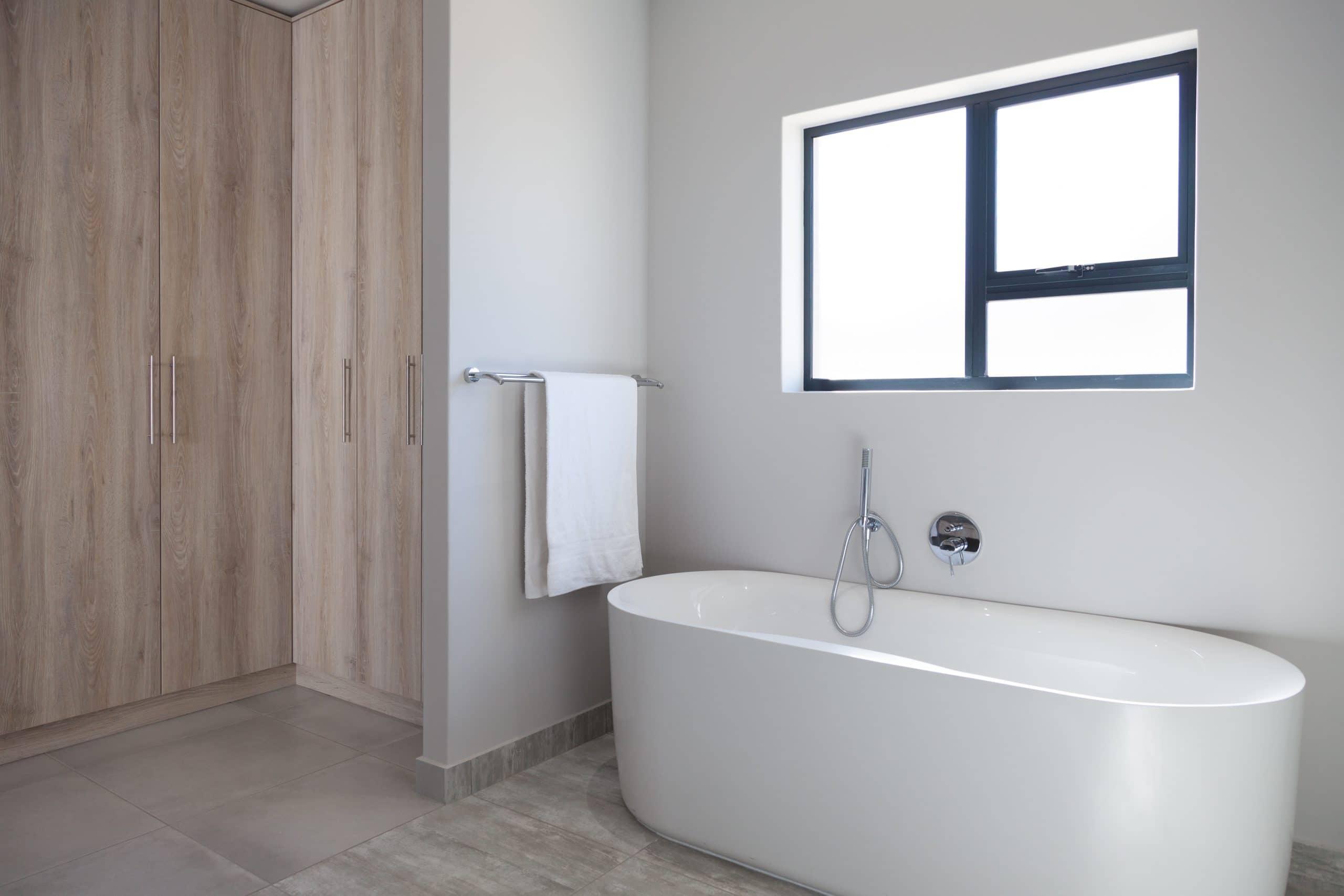 freestanding bath with wooden tile floor