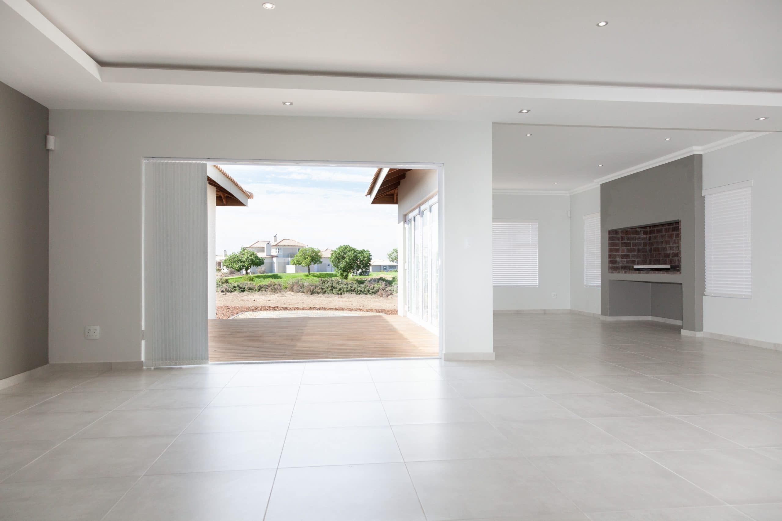 modern bulkhead ceiling living area overlooking built in braai and langebaan golf course