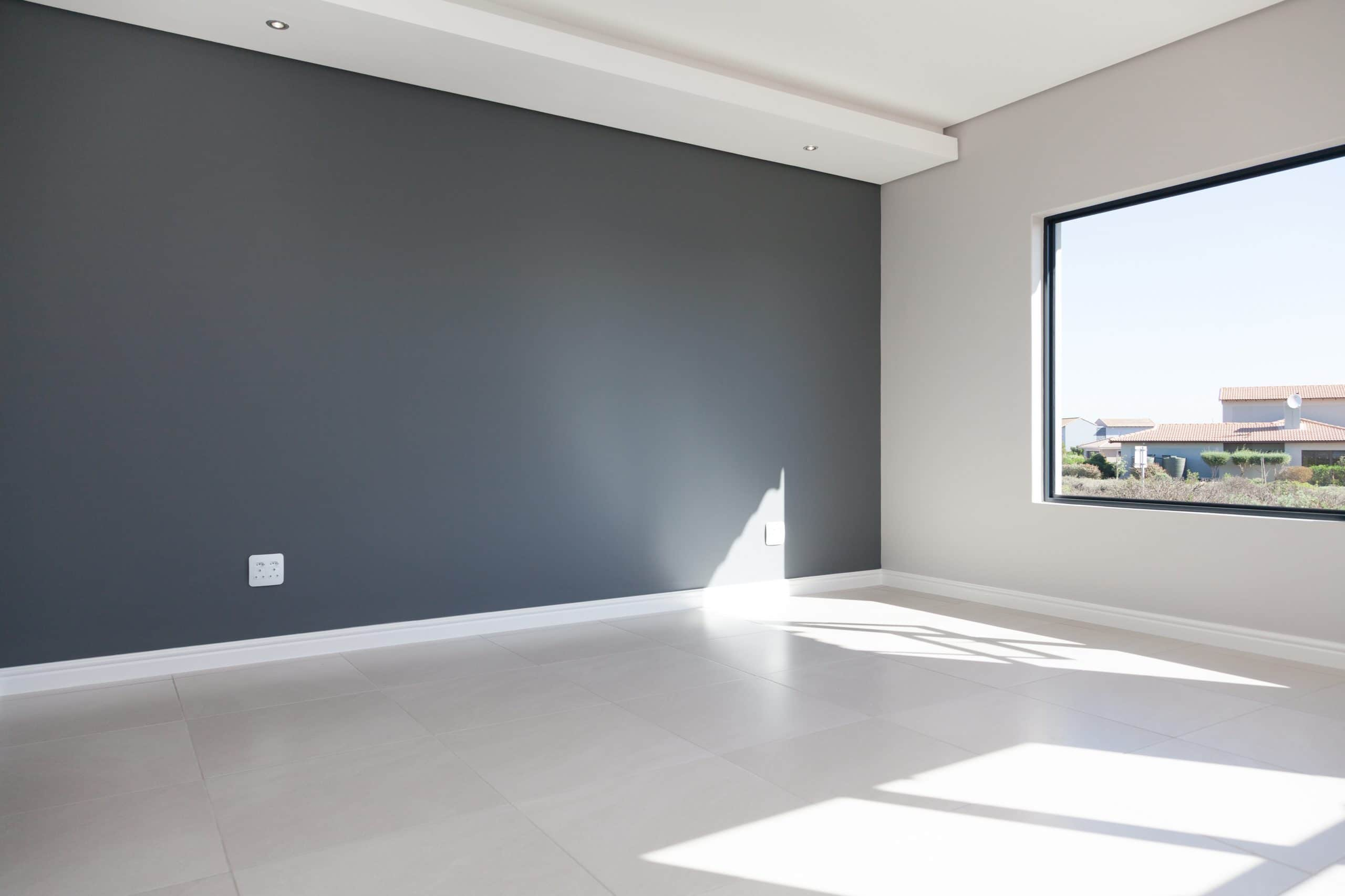 grey wall bedroom with pendant overlooking langebaan country estate sliding door